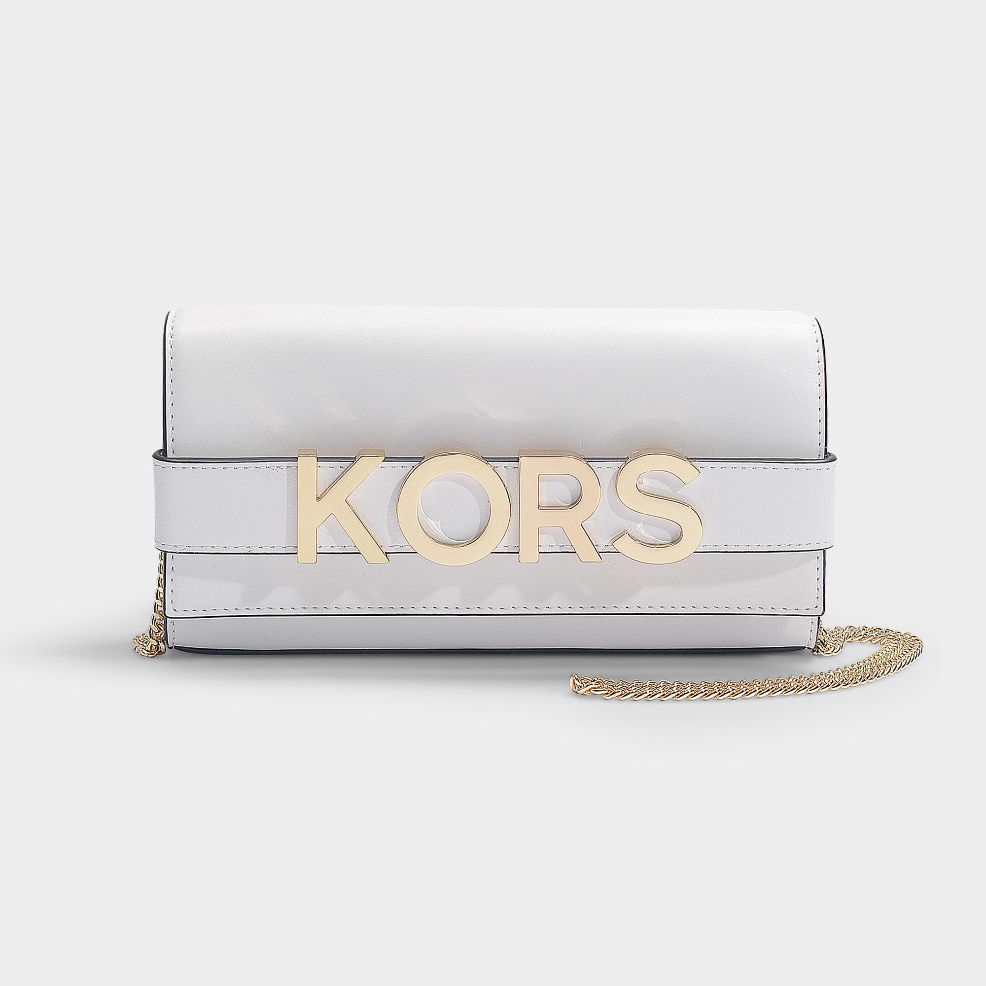 47e3dc5d0c1d MICHAEL Michael Kors. Women s Bellamie Large East west Strap Clutch Bag In Optic  White Calfskin