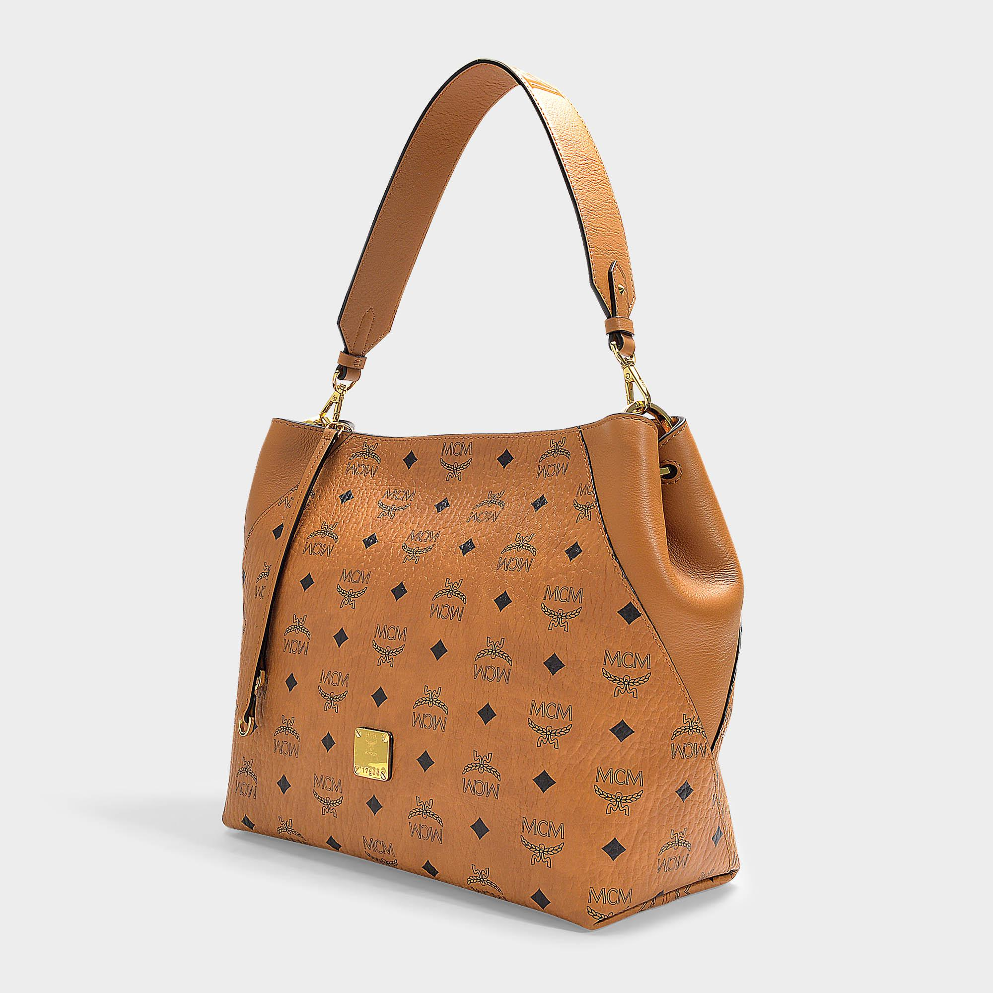 433a04b7aed5b Lyst - MCM Klara Visetos Hobo Medium Bag In Cognac Coated Canvas in ...