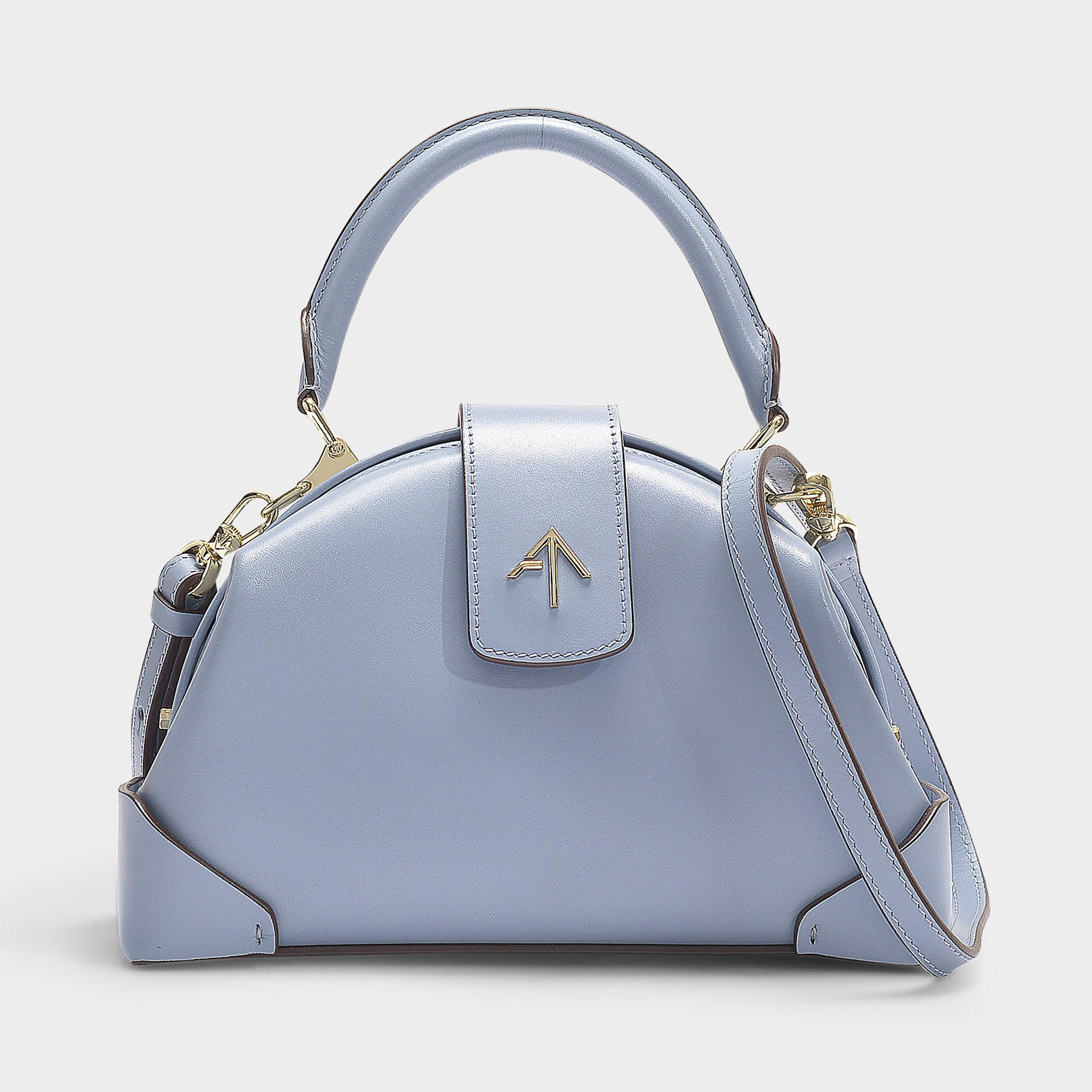 c99e268ae54b manu-atelier-Blue-Demi-Bag-With-Top -Handle-In-Ice-Blue-Vegetable-Tanned-Calf-Leather.jpeg