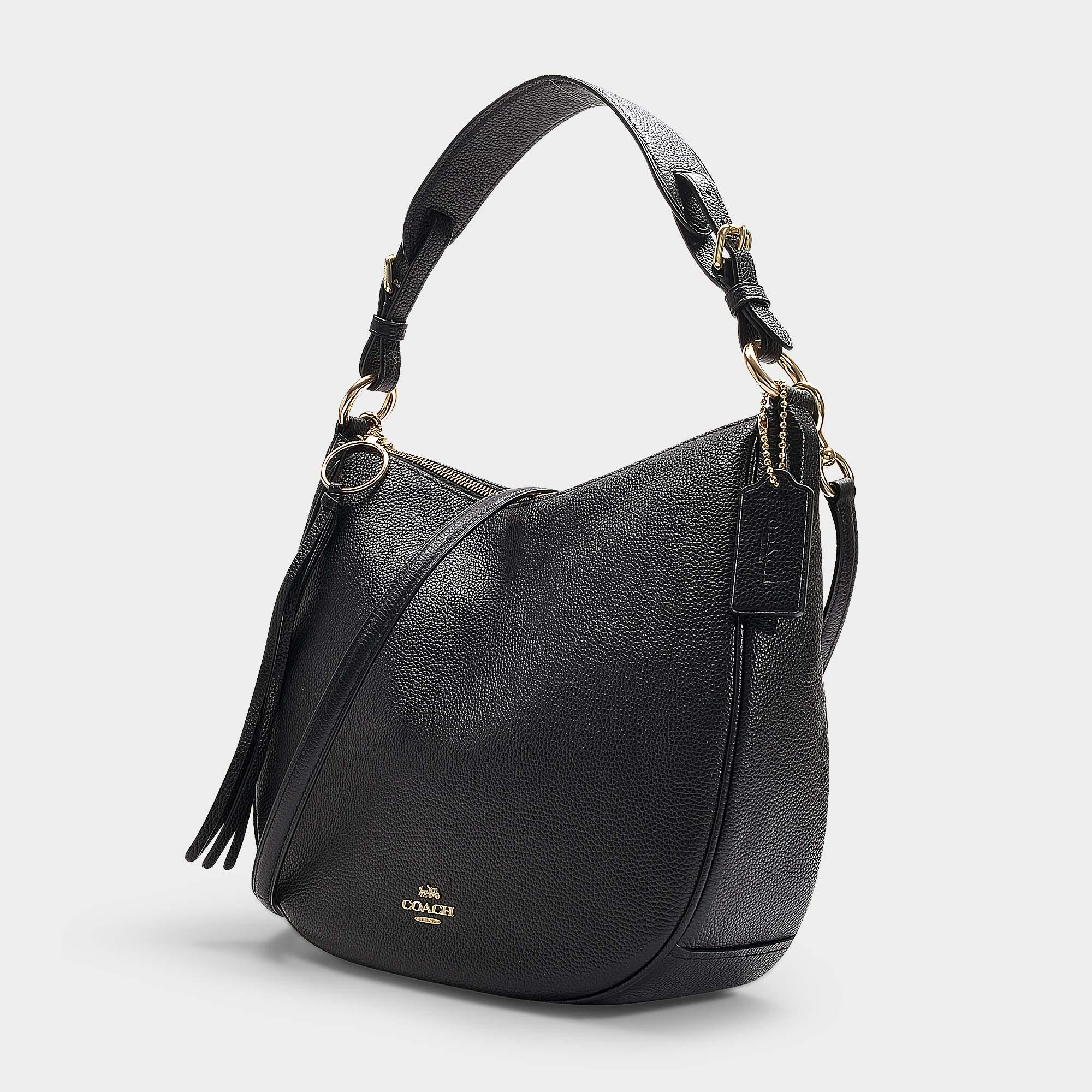 15a52549c990 COACH - Polished Pebble Leather Sutton Hobo Bag In Black Calfskin - Lyst.  View fullscreen