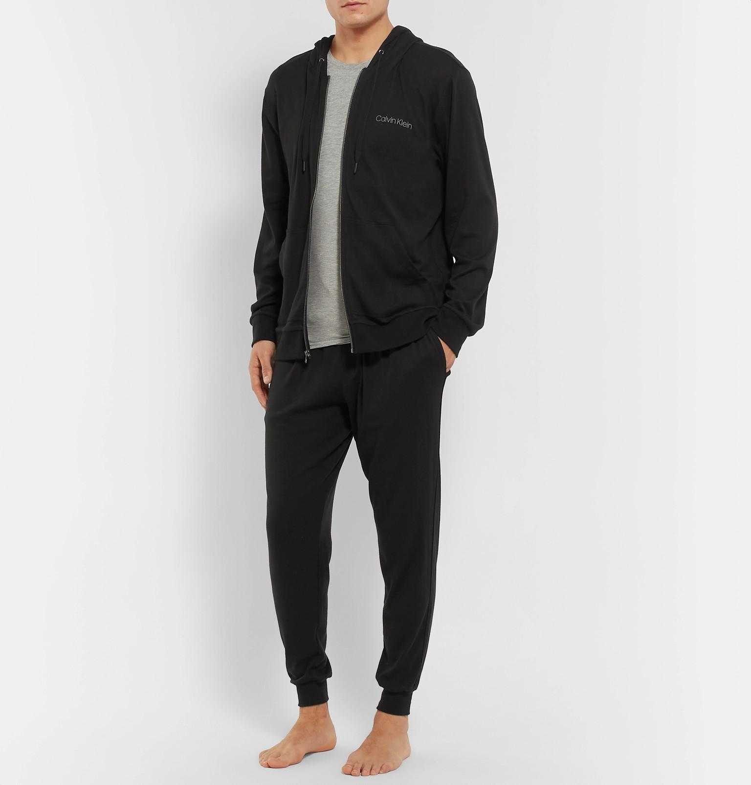 eb0d9083a7d6 Calvin Klein - Black Tapered Stretch Cotton And Modal-blend Sweatpants for  Men - Lyst. View fullscreen