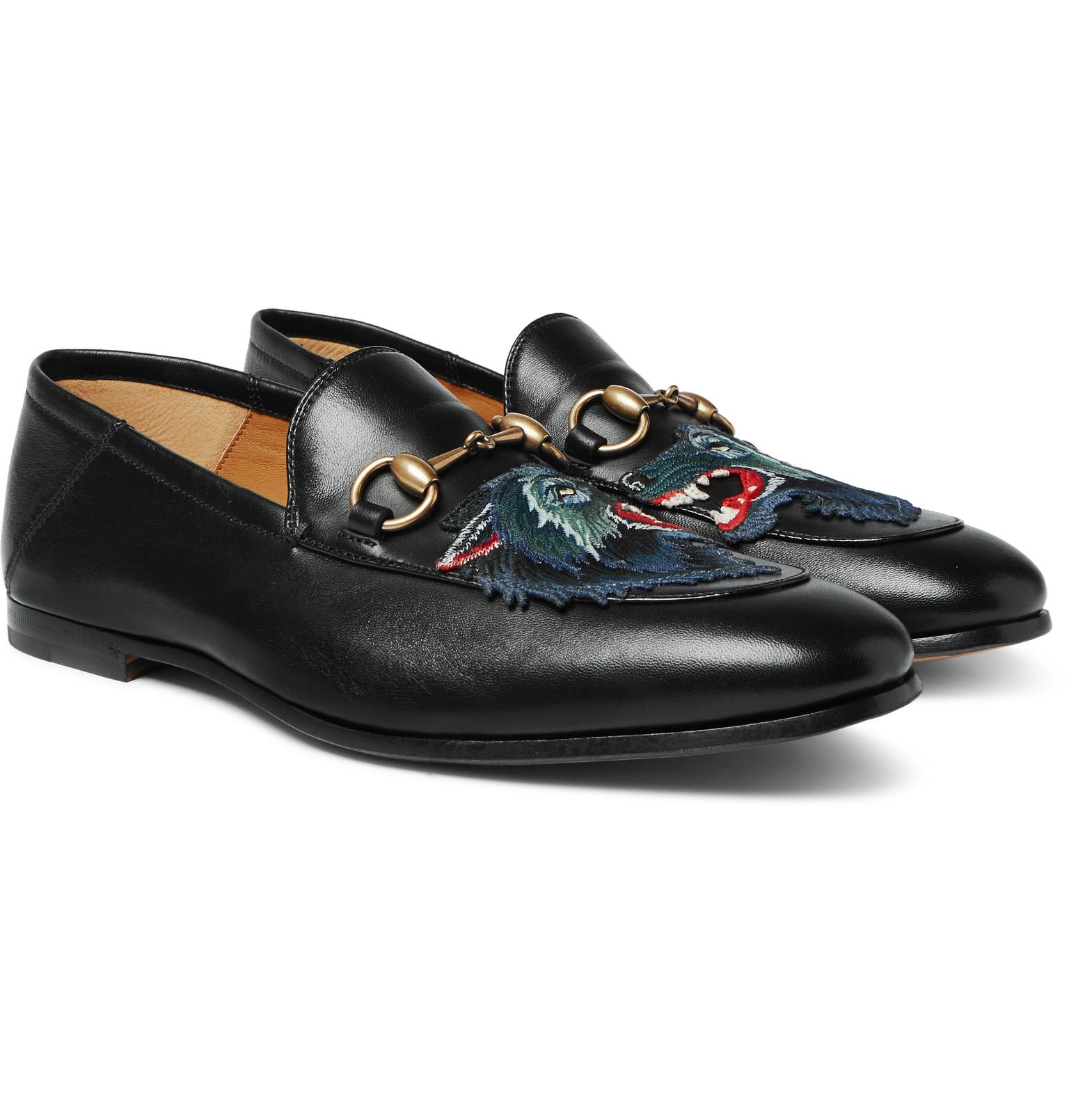 25c4d8944ff Gucci. Men s Black Brixton Horsebit Collapsible-heel Appliquéd Leather  Loafers