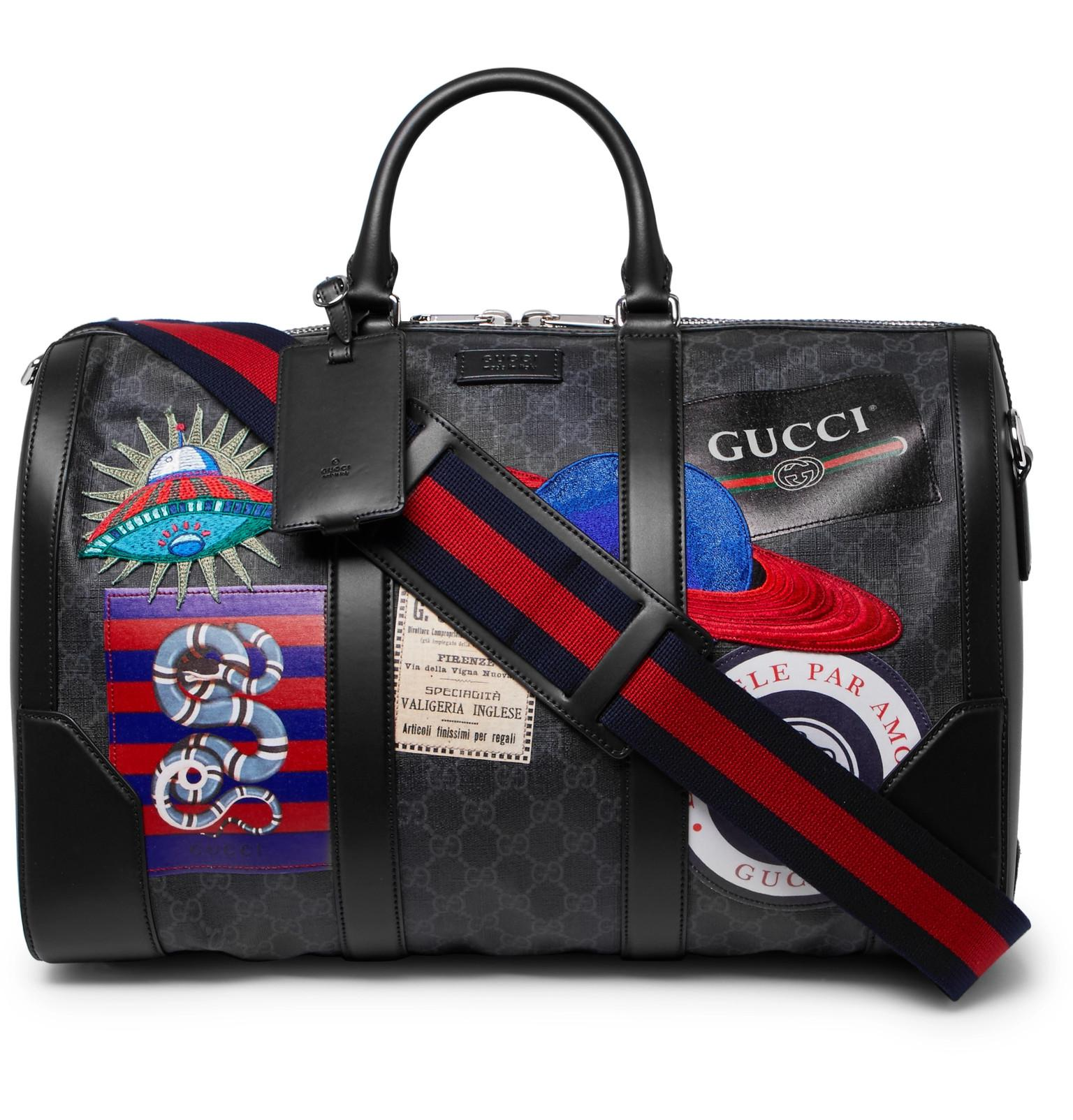 7749f8bb2 Gucci Night Courrier Leather-trimmed Appliquéd Monogrammed Coated ...