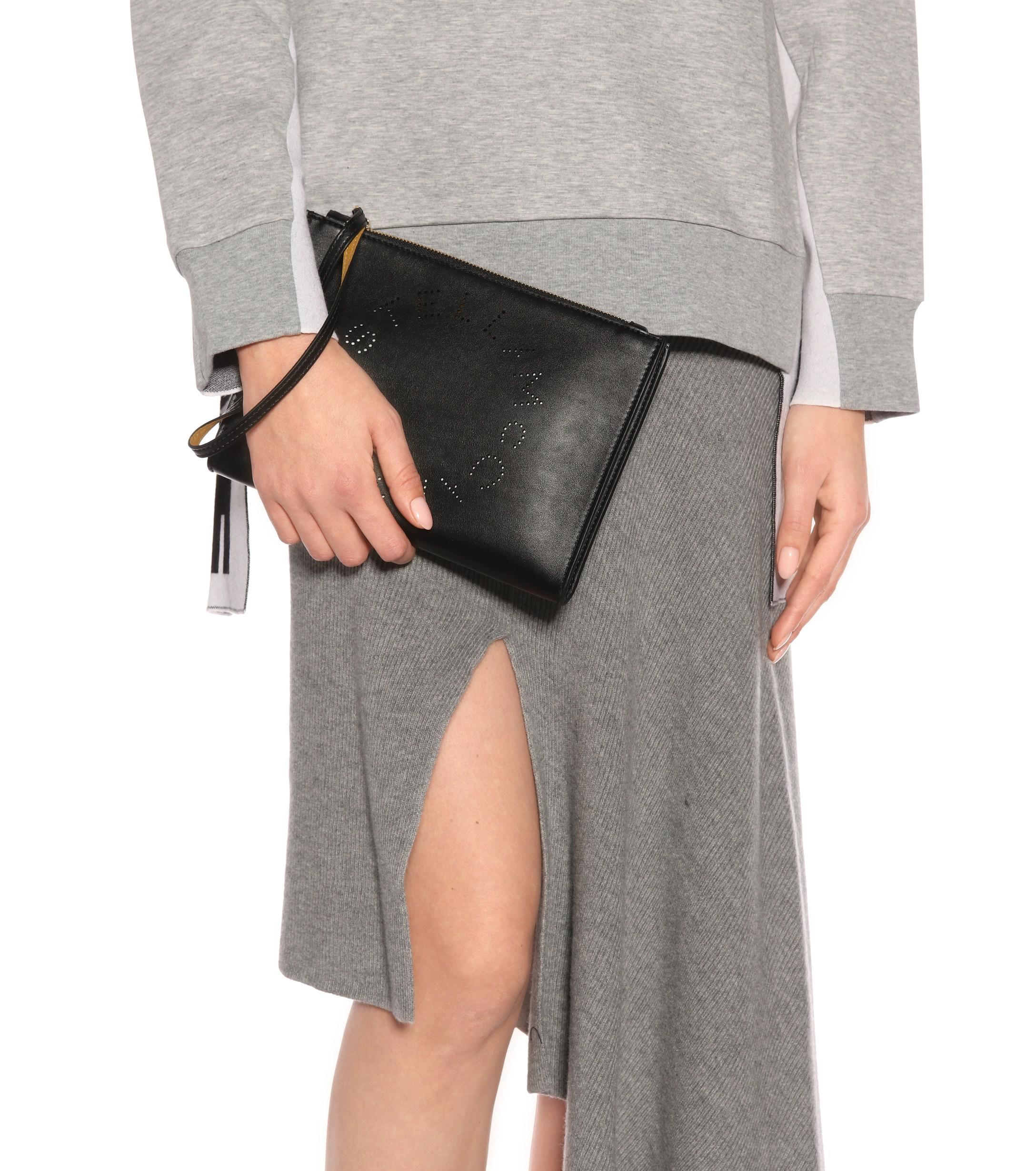 e75f7e70c0be Lyst - Stella Mccartney Stella Logo Faux Leather Clutch in Black