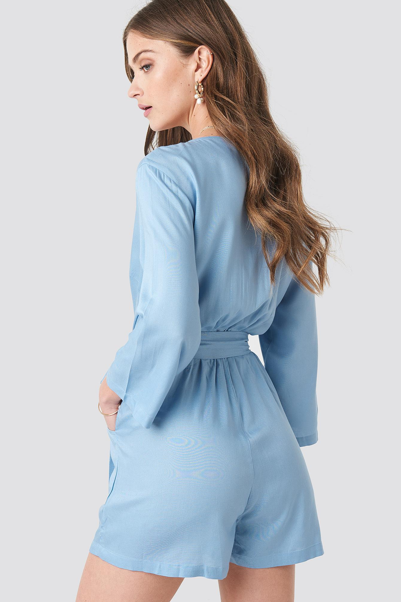 42f8c5632d1 NA-KD Wrap Playsuit Light Blue in Blue - Lyst