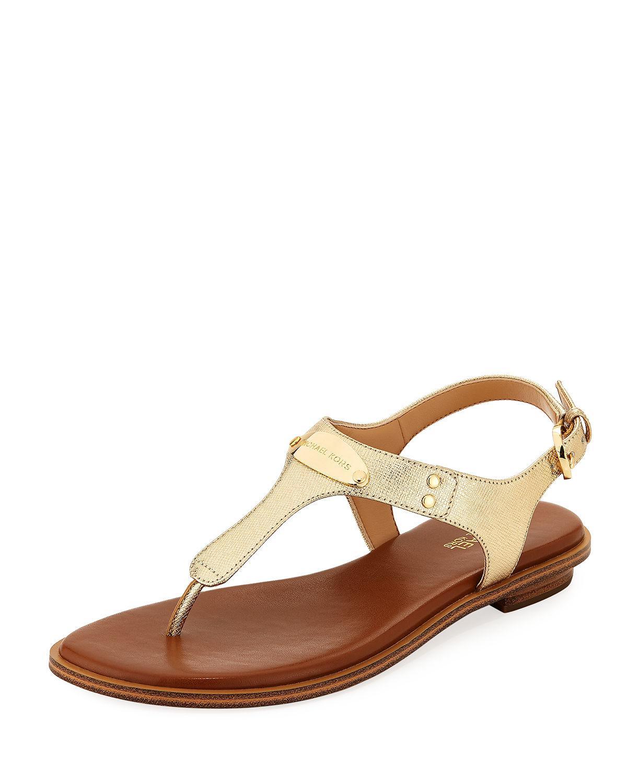 87bea4078b4f MICHAEL Michael Kors. Women s Mk Plate Metallic Saffiano Flat Thong Sandal
