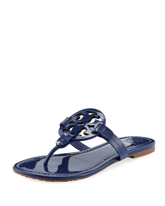 cf9c7598b58f Tory Burch. Women s Blue Miller Medallion Patent Leather Flat Thong Sandals