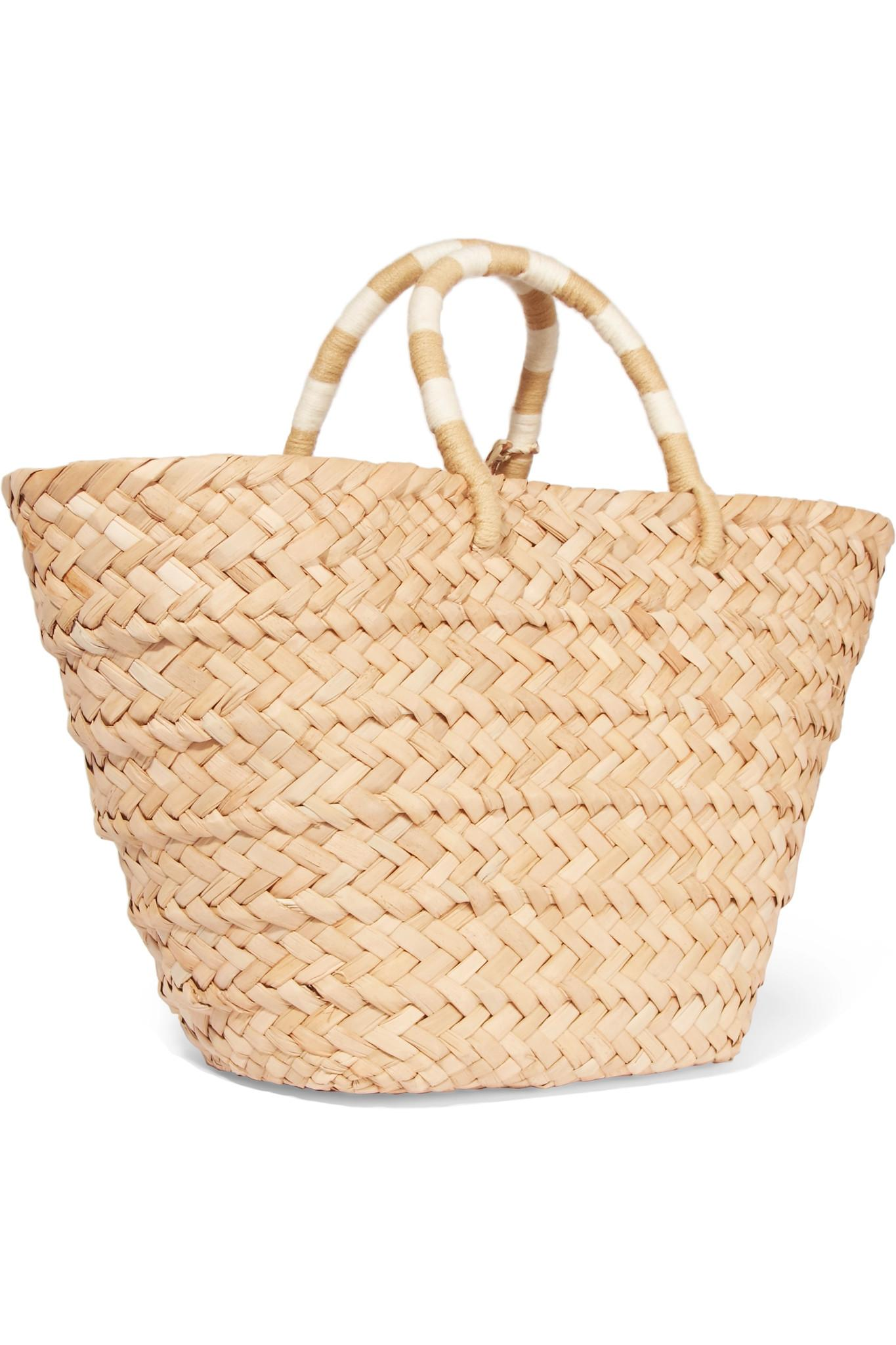 kayu st tropez pompom embellished woven seagrass tote in