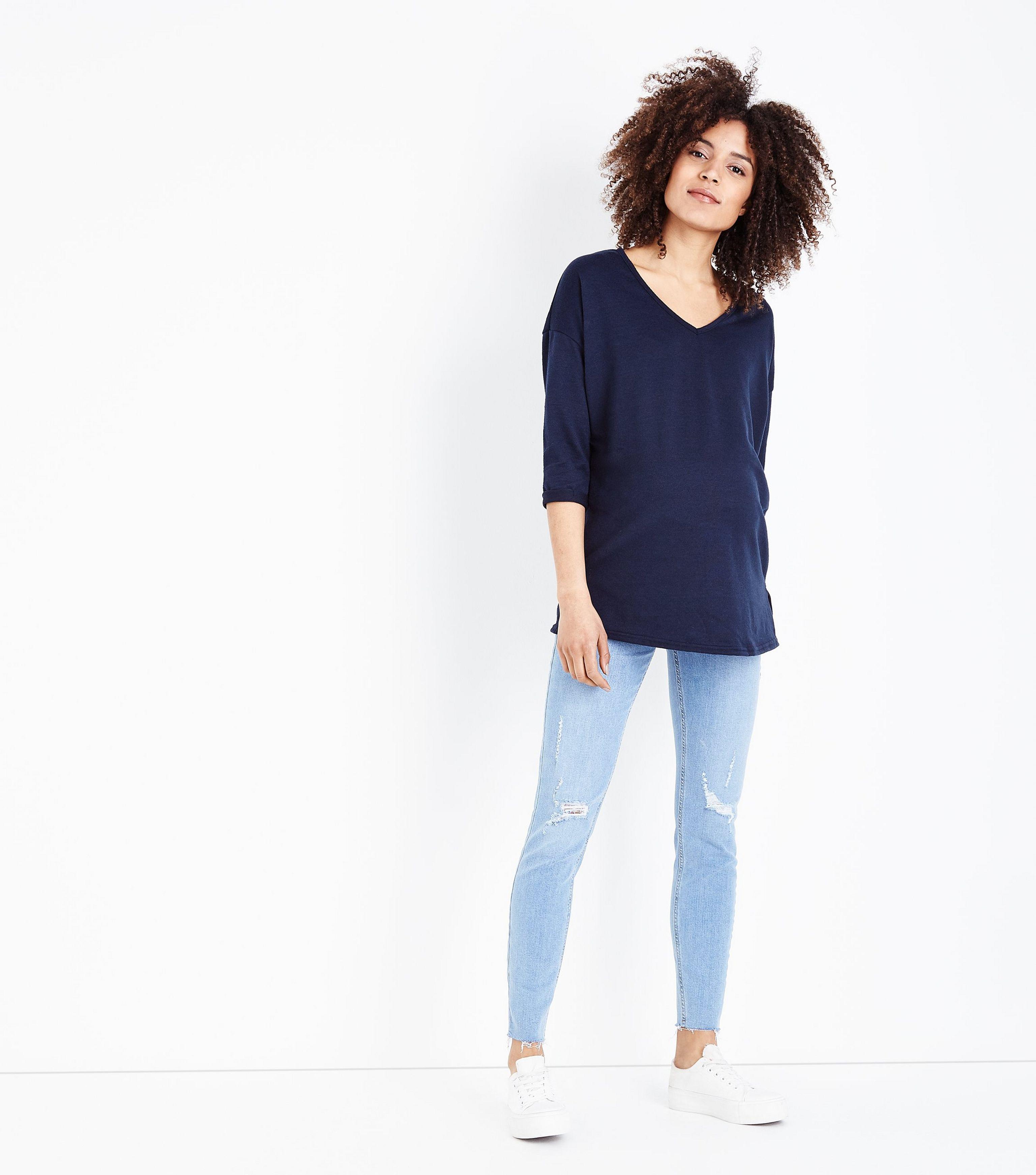 c024e3c82fbbe New Look Maternity Pale Blue Ripped Raw Hem Under Bump Skinny Jeans ...