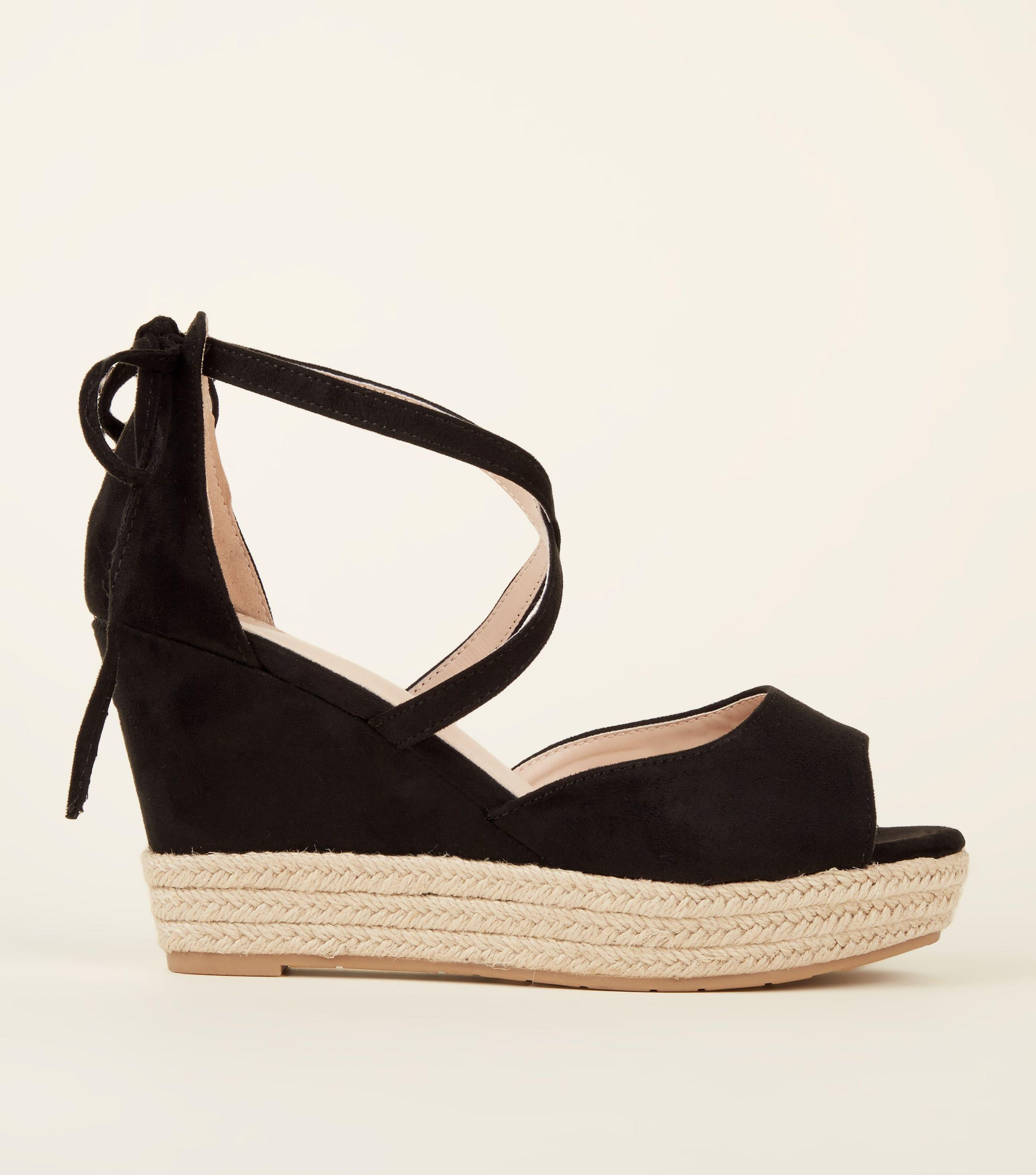 75010c55bfc New Look Black Suedette Bow Back Peep Toe Wedges in Black - Lyst
