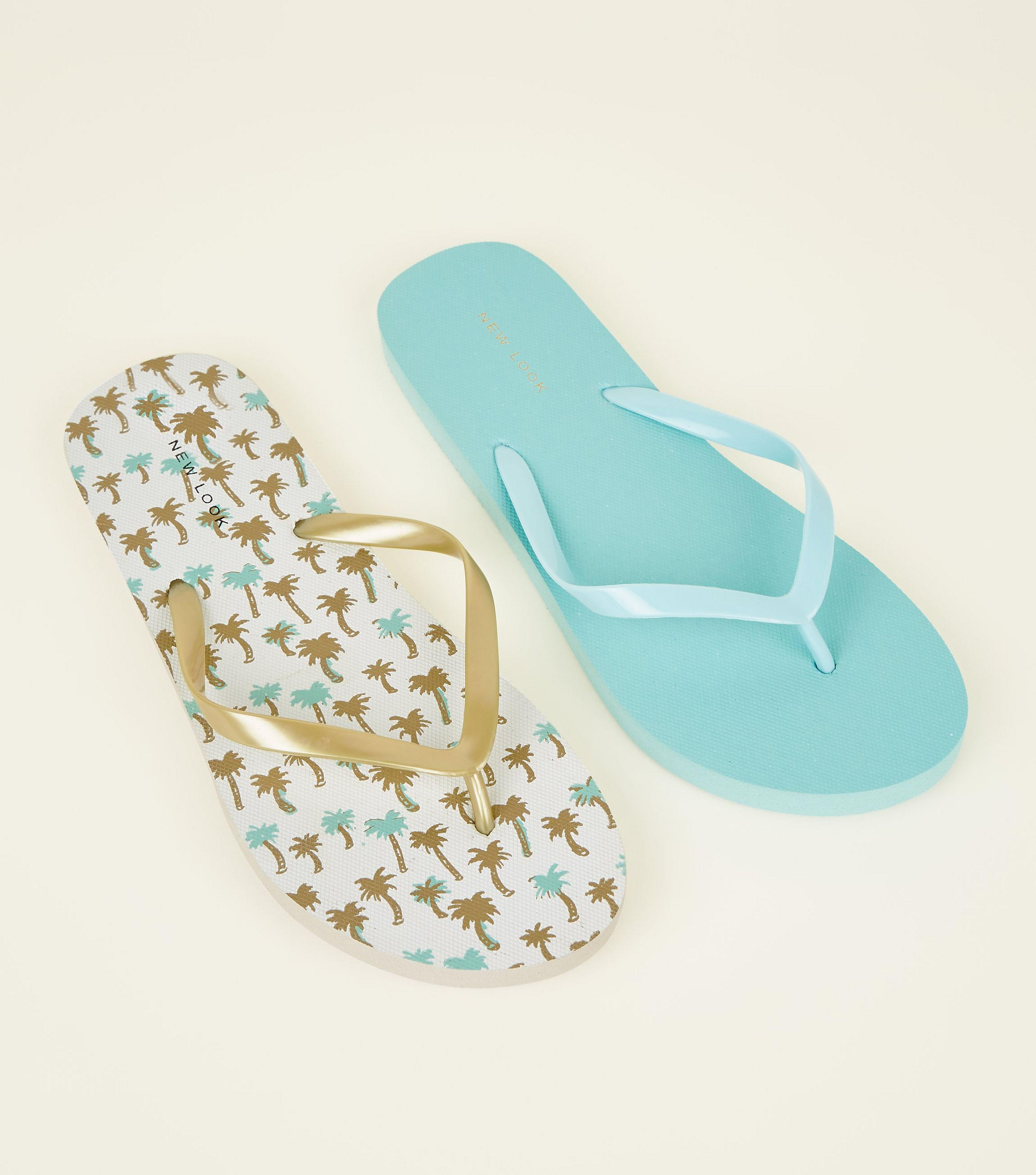 9258e829f28c2 New Look 2 Pack Gold And Blue Tropical Print Flip Flops in Metallic ...