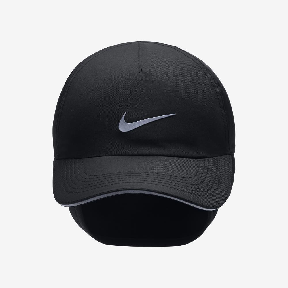 ba7b7cab1a5 Lyst - Nike Aerobill H86 Ear Flap Women s Adjustable Running Hat ...