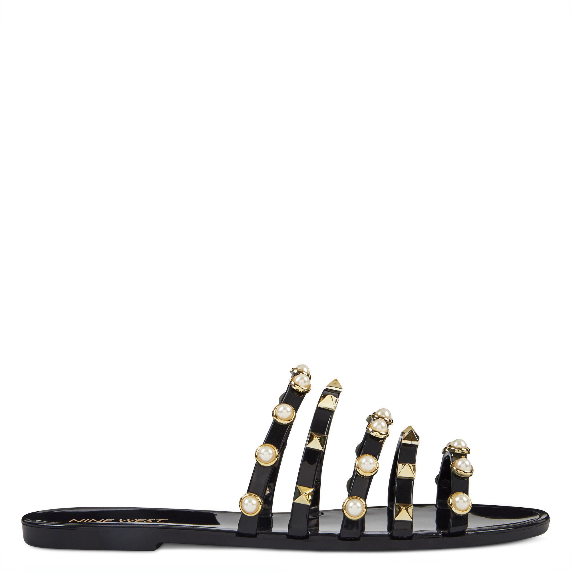e61b4b023ae Lyst - Nine West Cariana Jelly Slide Sandals in Black