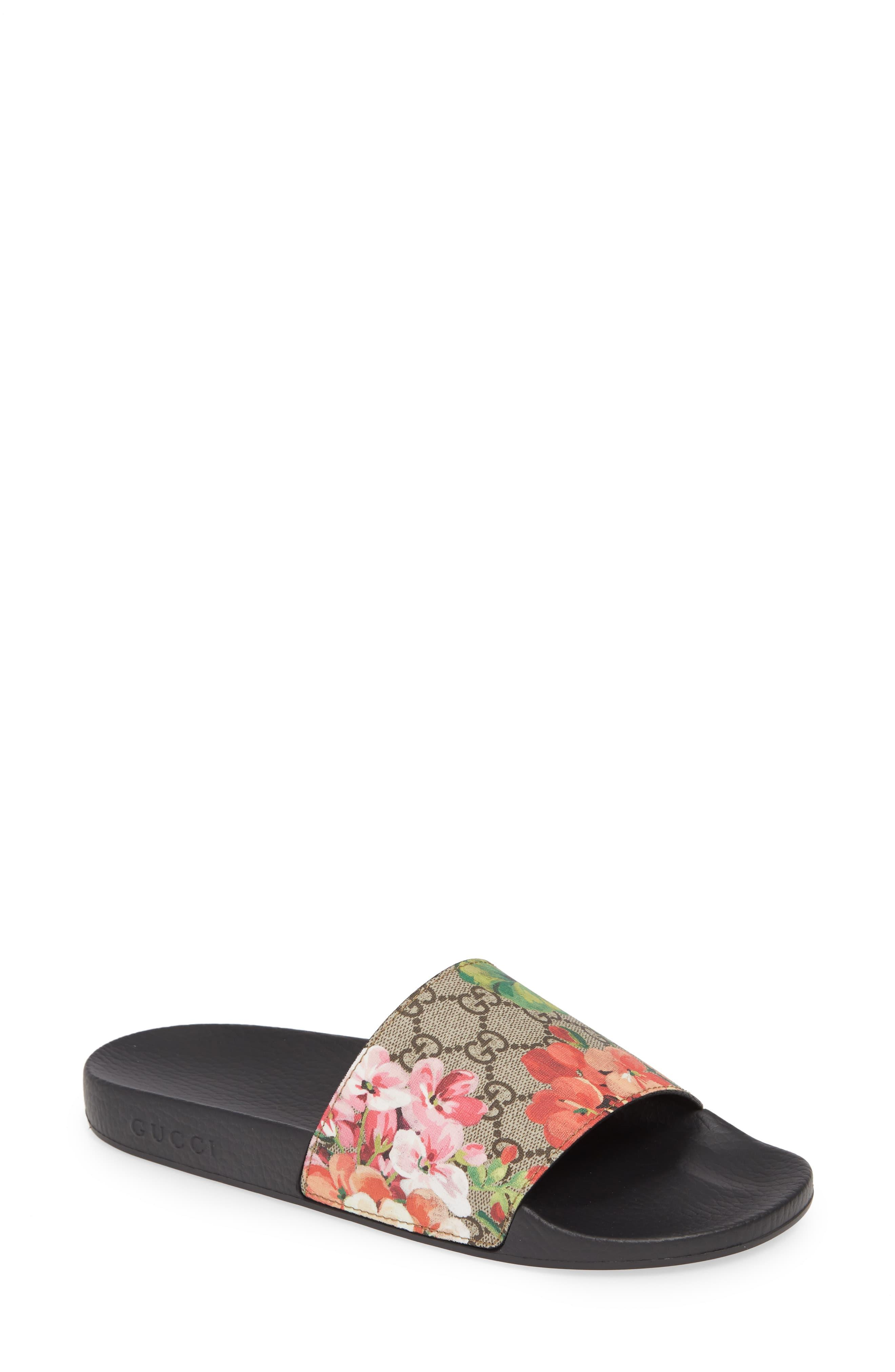 3c3f042e4 Gucci. Women's Blooms Supreme Canvas Slides