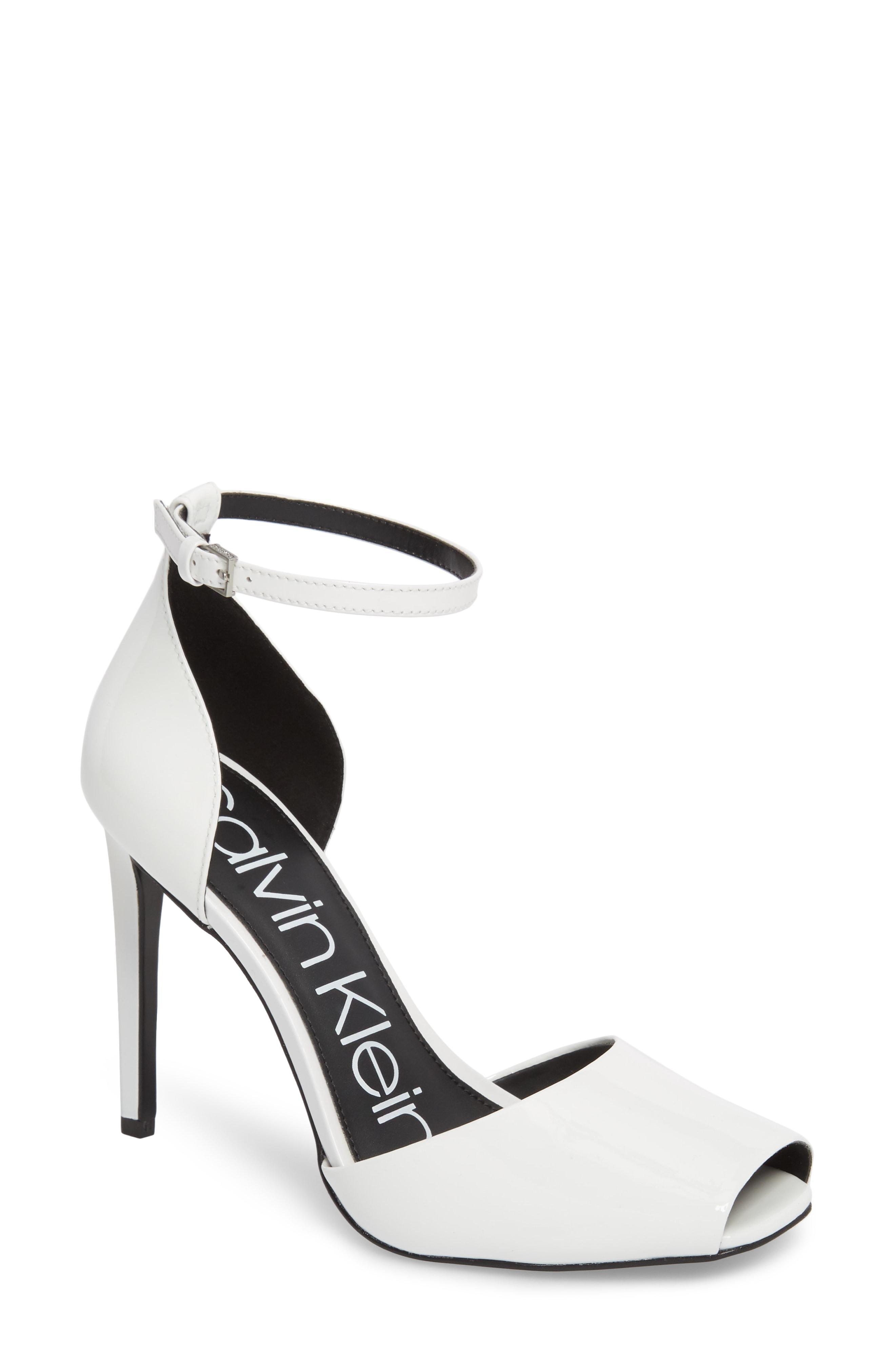4a2a253aae8 Lyst - Calvin Klein Daros Peep-toe Pump in White