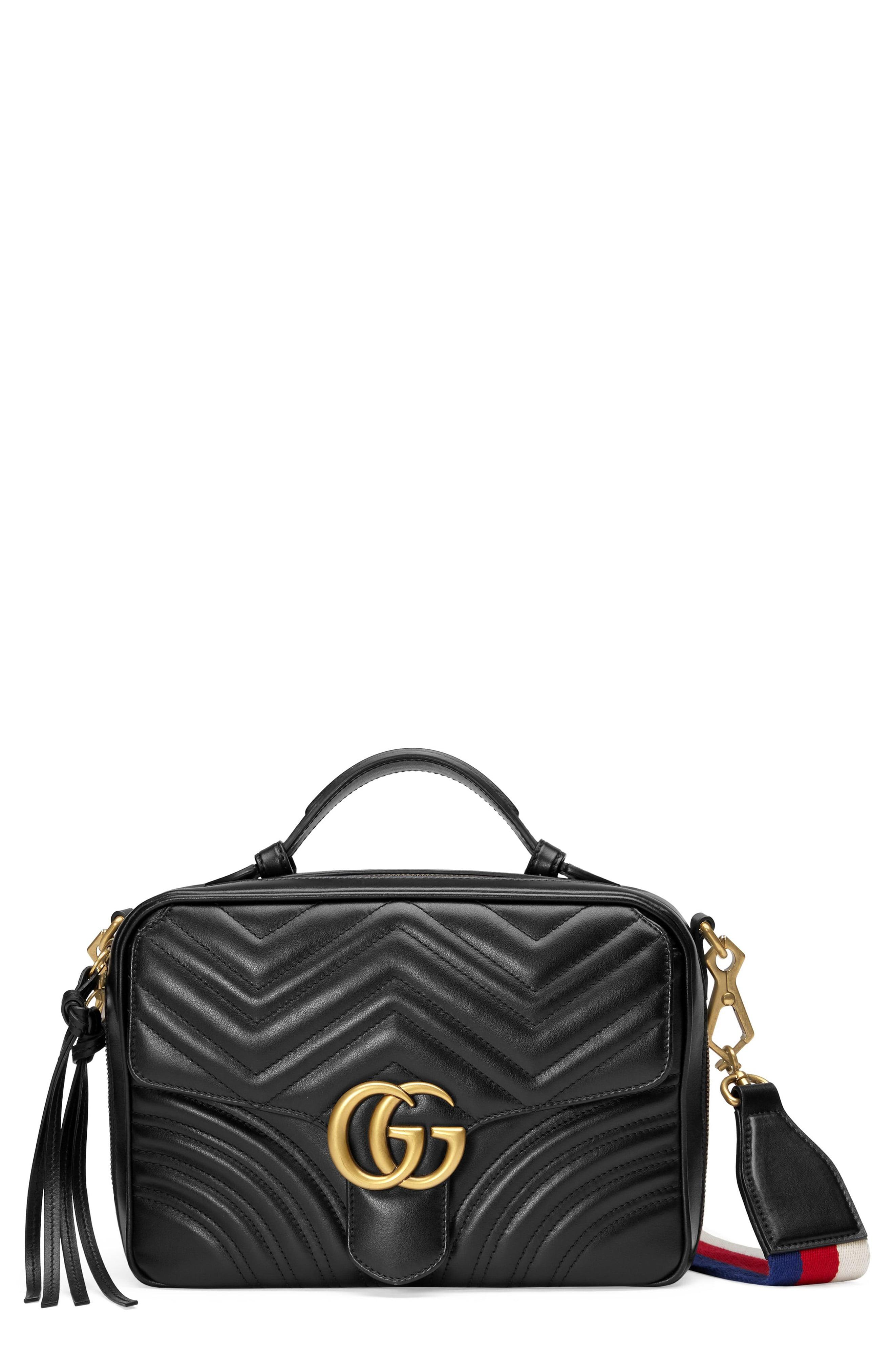 bfb65f07c252 Gucci. Women s Black Small Gg Marmont 2.0 Matelassé Leather Camera Bag With Webbed  Strap -