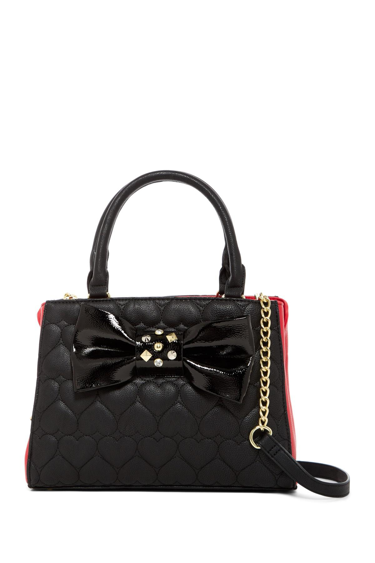 8993d4c2079 Lyst - Betsey Johnson Heart Quilted Bow Bowler Satchel in Black