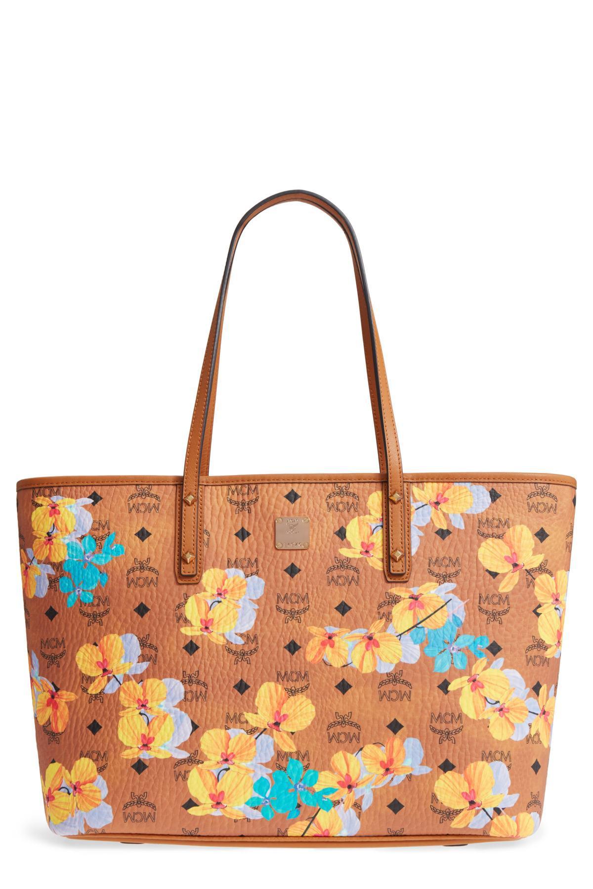 88ea094a56 Lyst - MCM Essential Visetos Floral Print Cognac Top Zip Medium Tote Bag