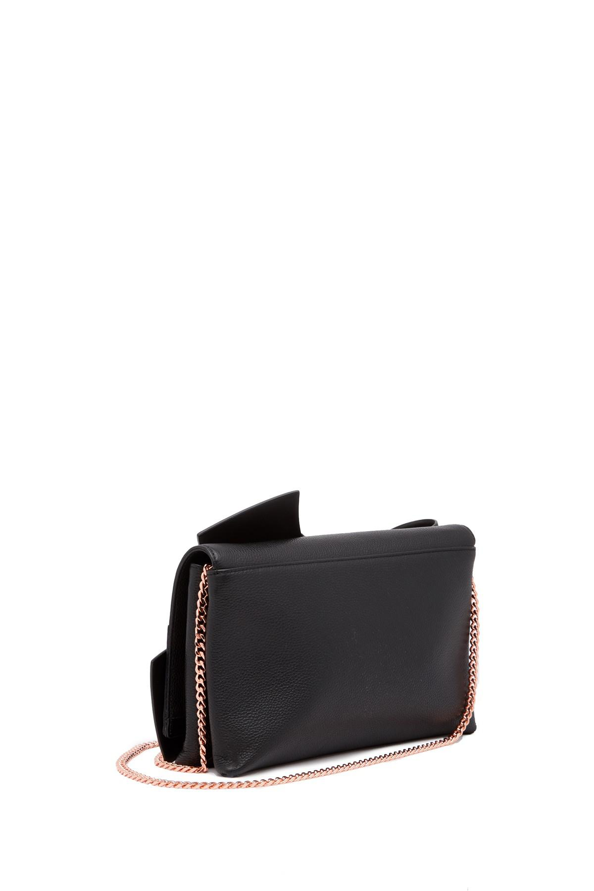 48299600a3c48 Lyst - Ted Baker Asterr Giant Knot Bot Leather Clutch Bag in Black