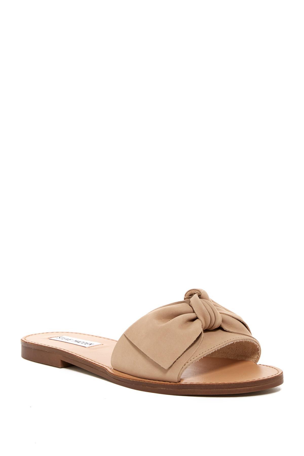 f3226ffe0928 Lyst - Steve Madden Diora Bow Slid Sandal in Natural