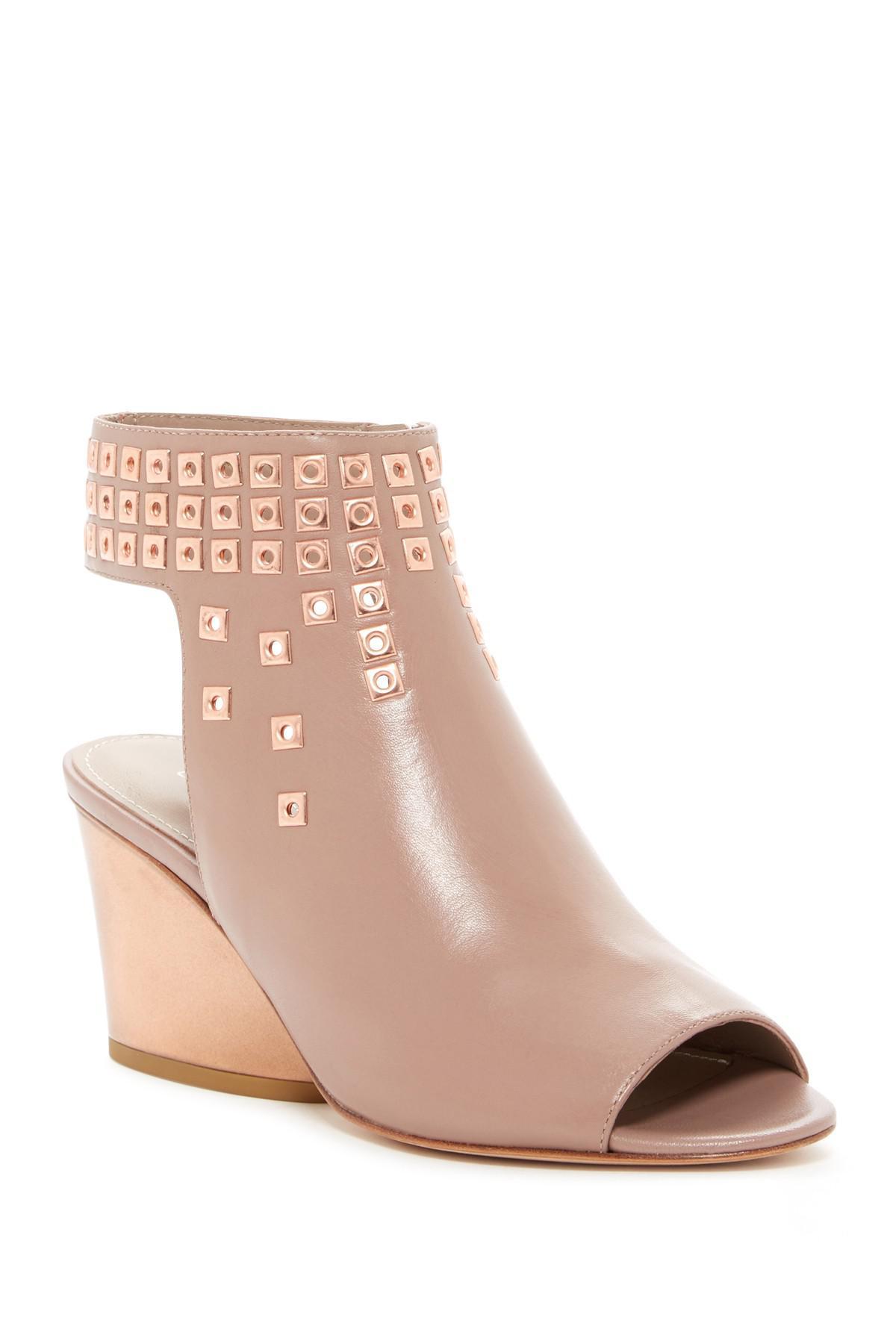 57fd0358d67 Donald J Pliner. Women s Jane Studded Wedge Sandal