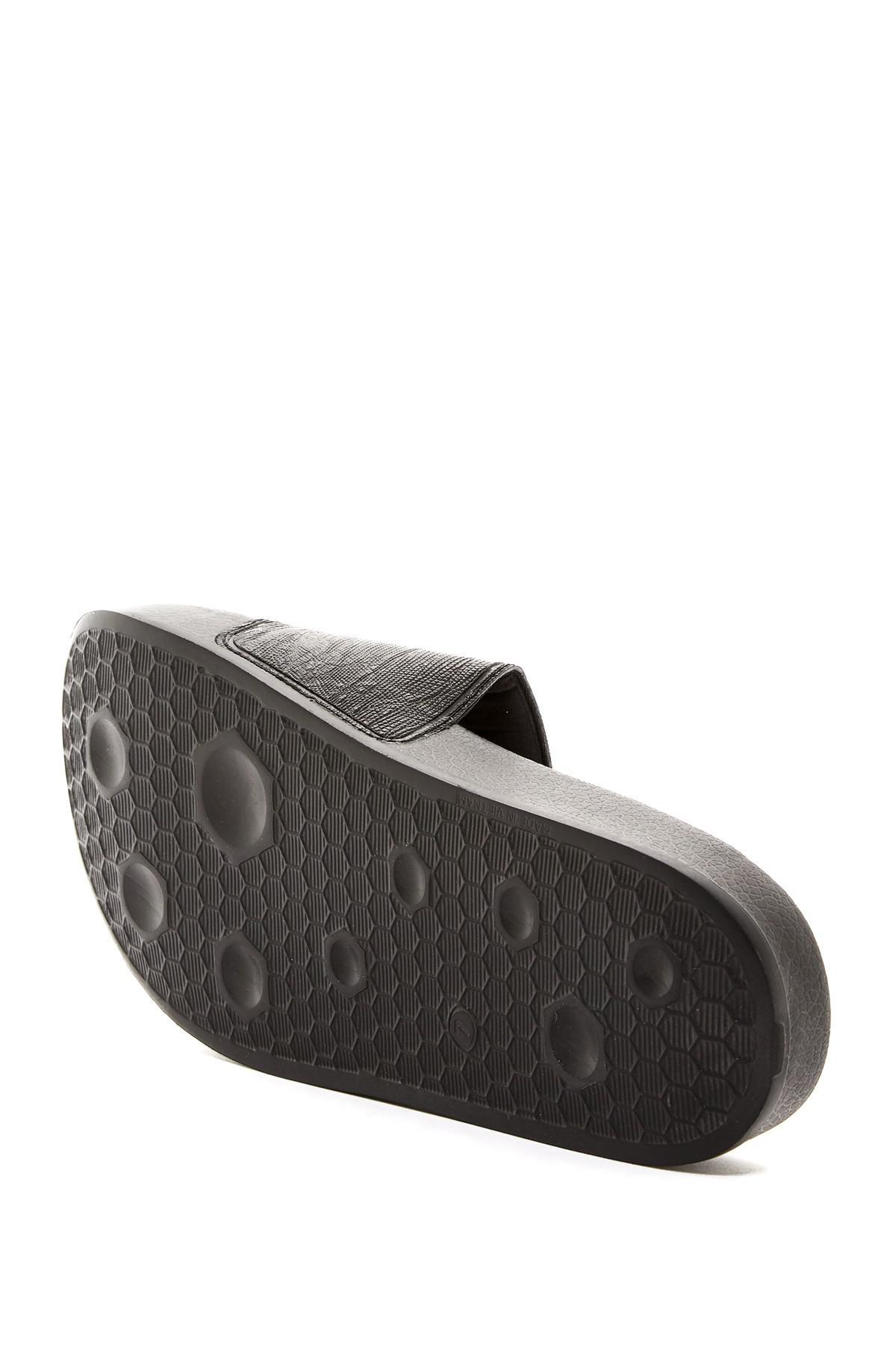 4352ceb6506b4b PUMA - Black Leadcat Embossed Slide Sandal - Lyst. View fullscreen