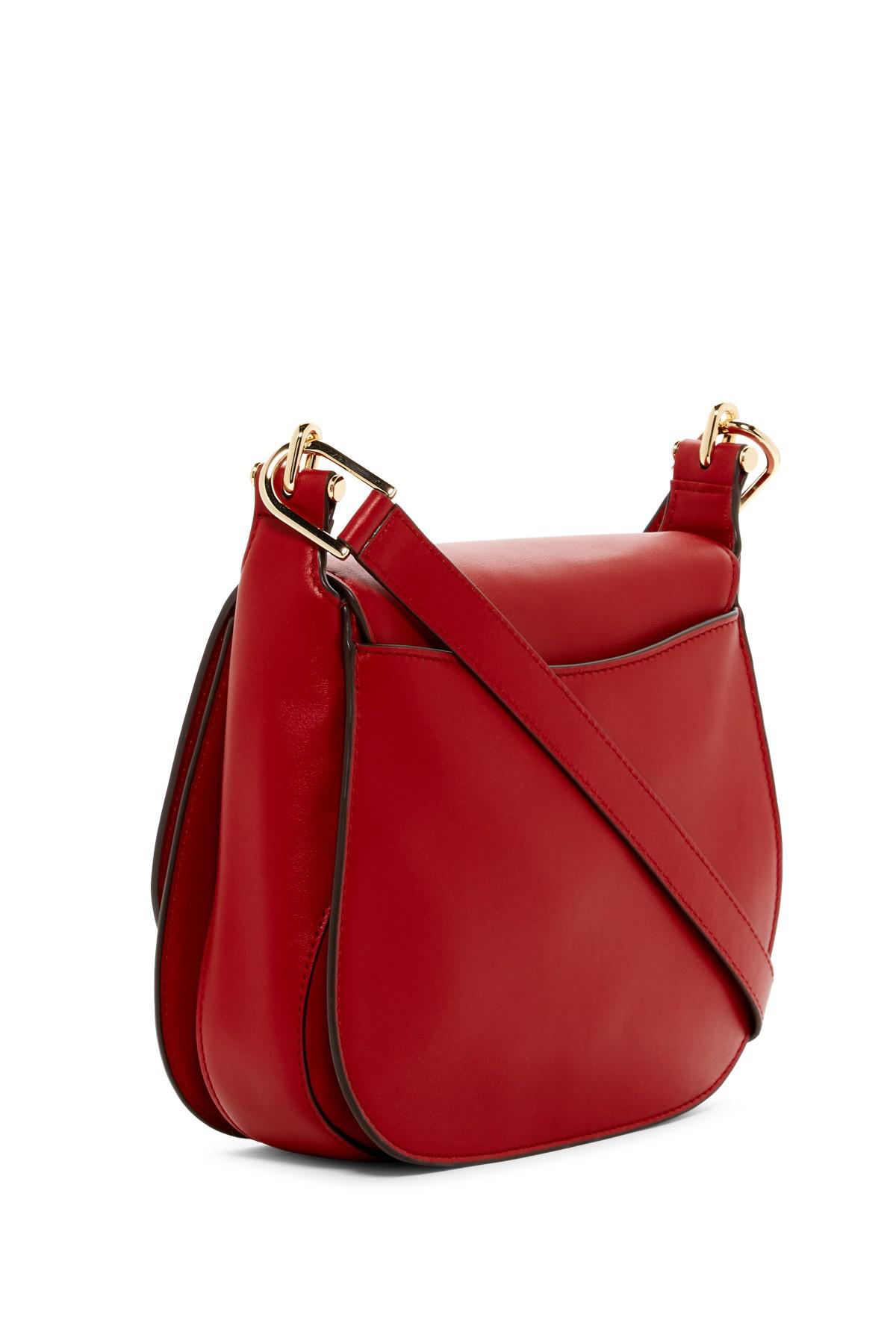 bf5831d32294 Lyst - MICHAEL Michael Kors Delfina Large Leather Saddle Bag in Red