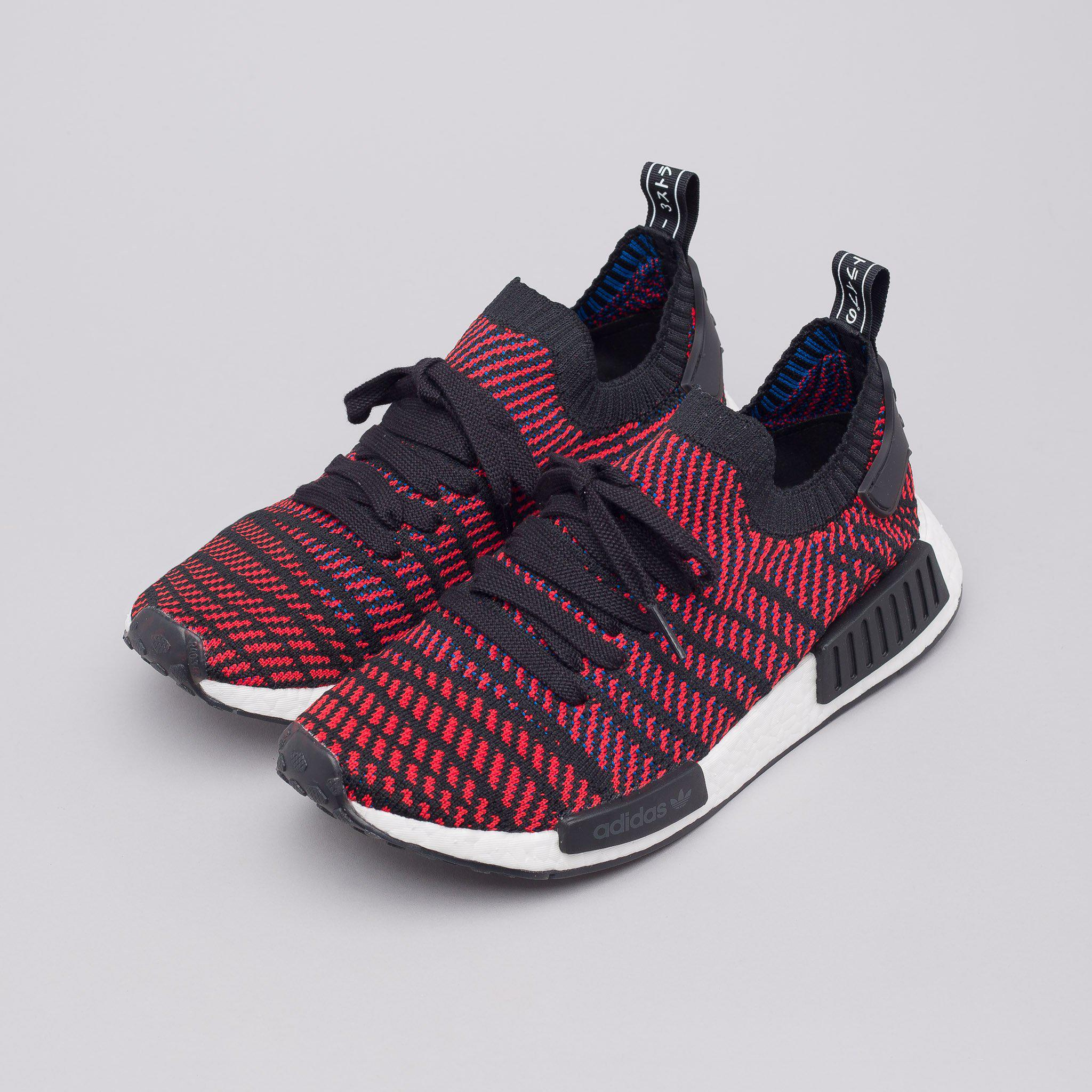 69c309072 ... denmark lyst adidas nmd r1 primeknit stlt in core black red blue in red  ec41f 7893f