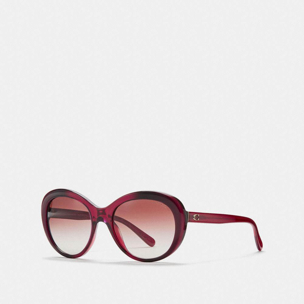 e4313595dc46 order lyst coach beveled edge oval sunglasses 87598 2be55