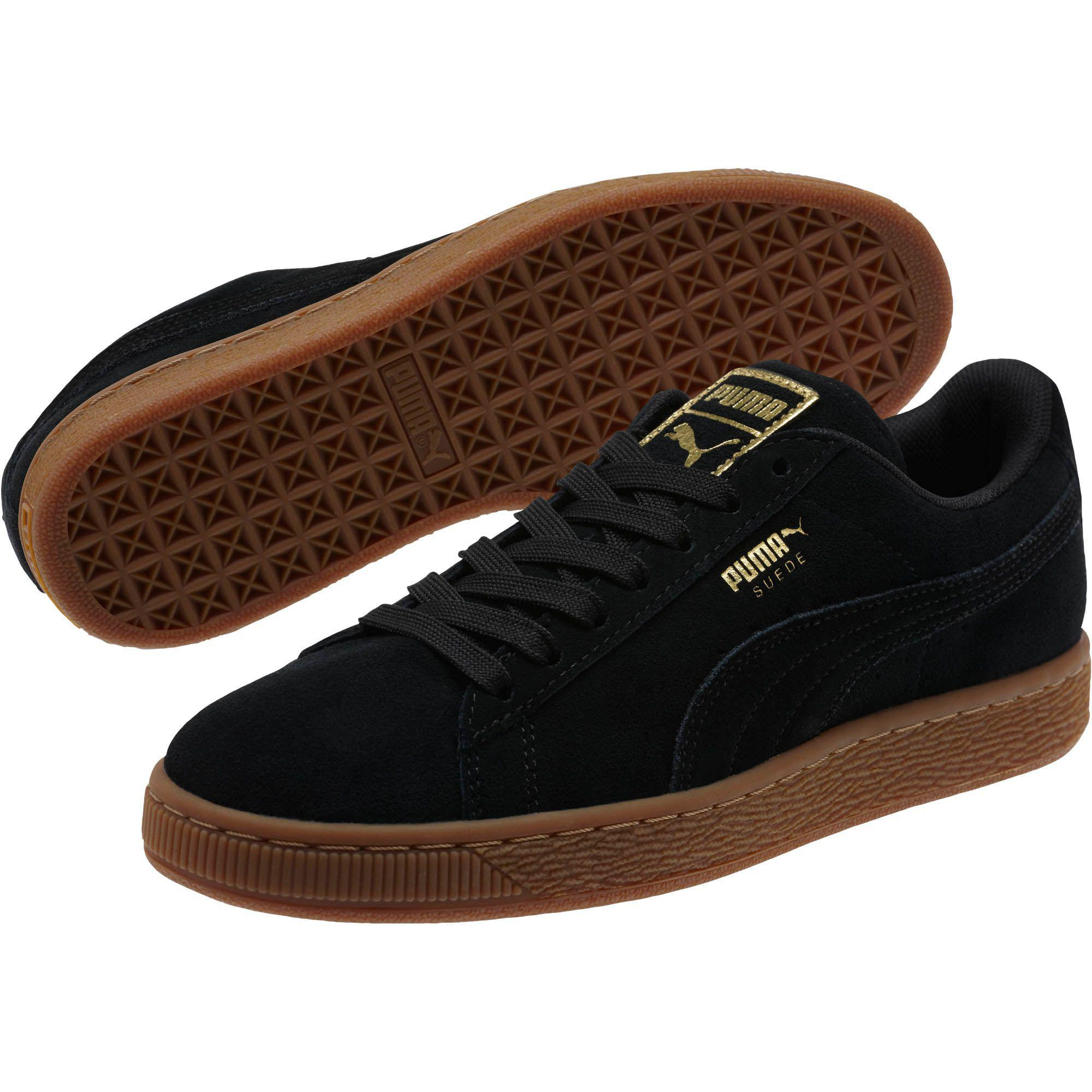 9a27fd95bb2 Lyst - PUMA Suede Classic Gold Women s Sneakers in Black