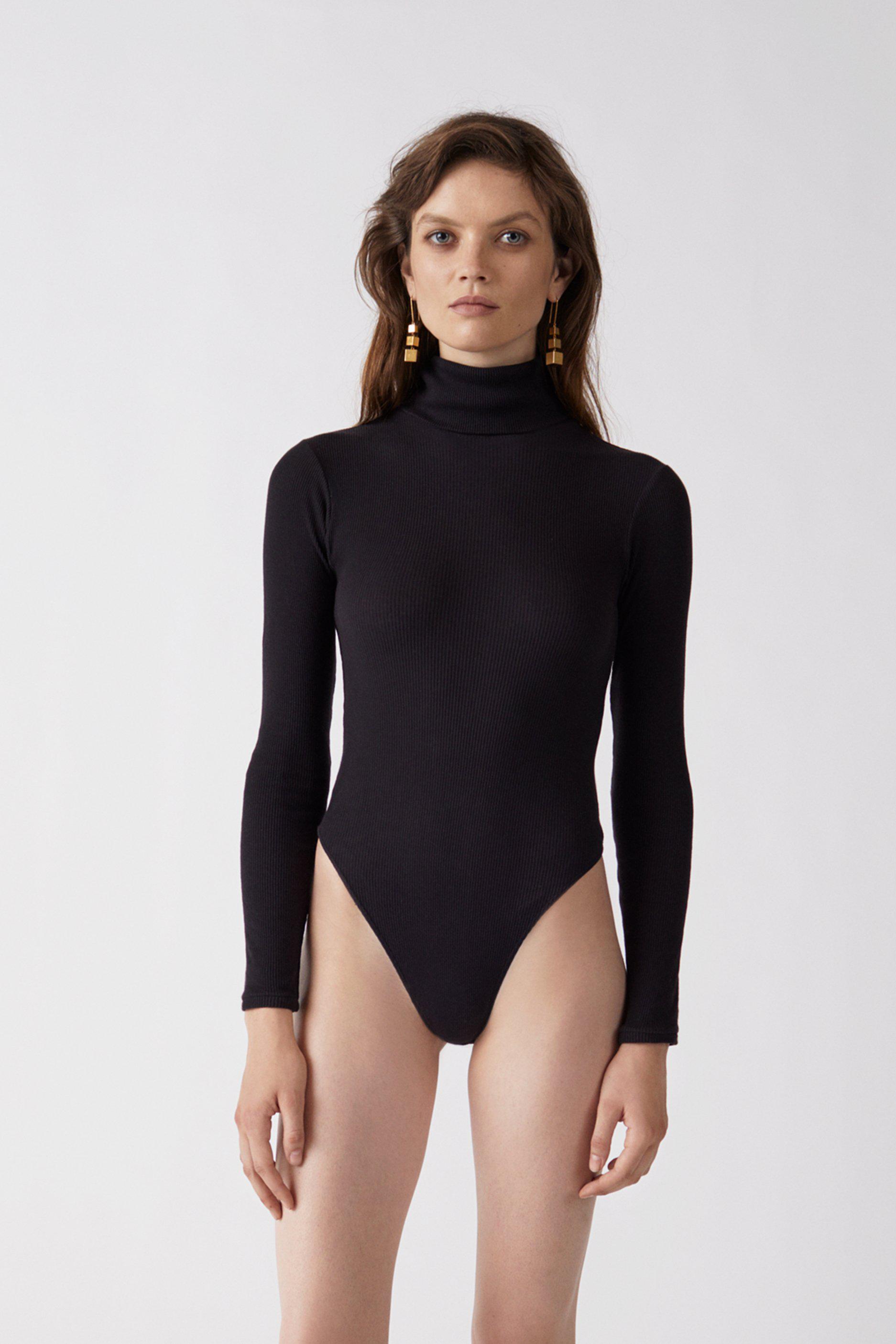 Lyst - RE DONE Originals Ribbed Turtleneck Bodysuit in Black 4606fcc66