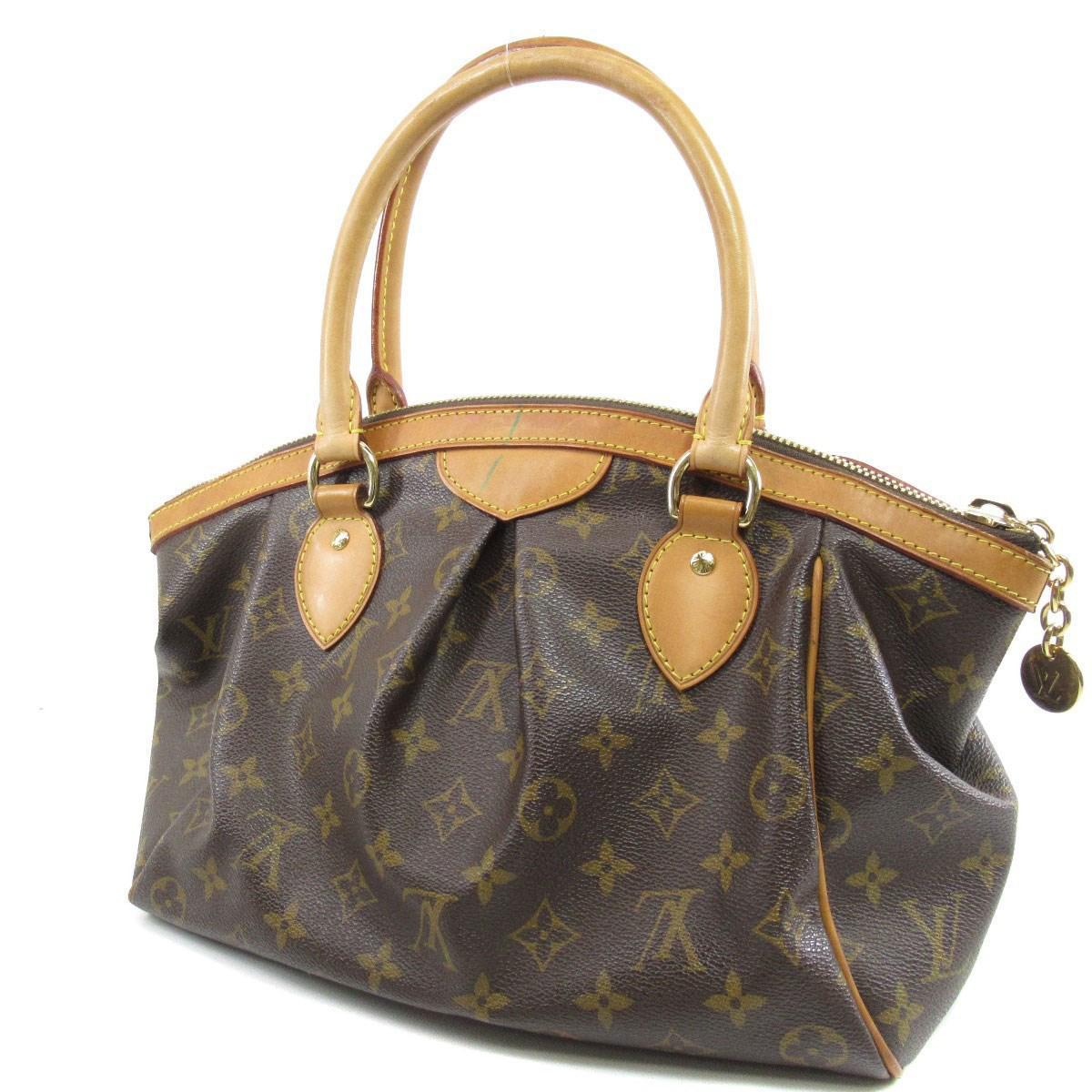 ff0ccbefff4e Lyst - Louis Vuitton Monogram Canvas Handbag M40143 Tivoli Pm in Brown