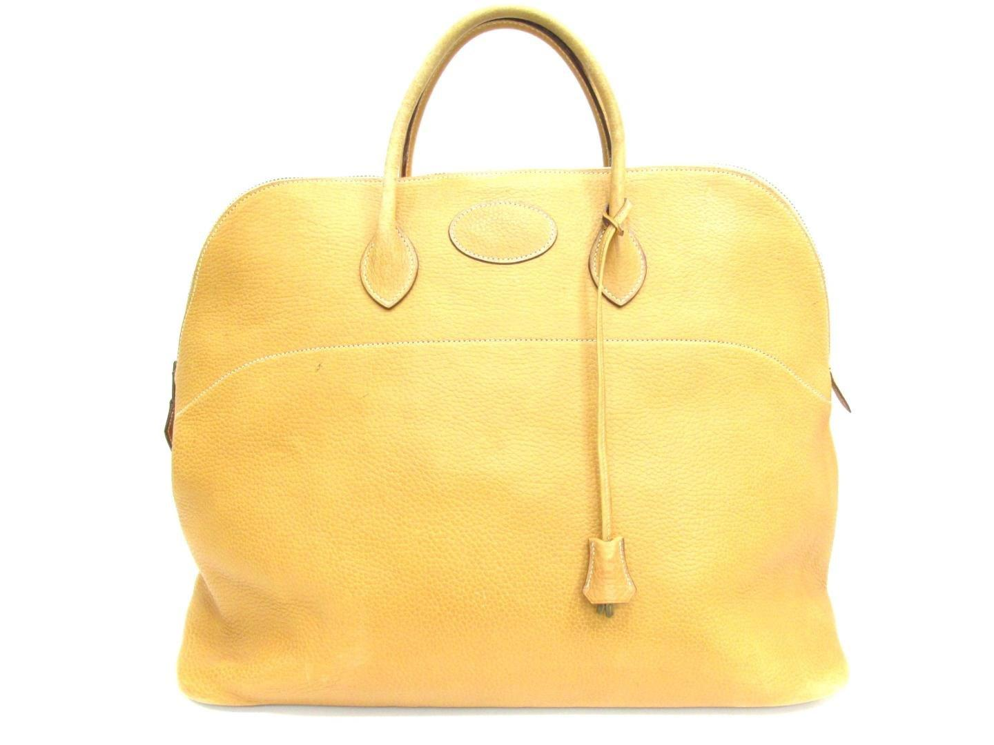 69b760df40 real lyst hermès bolide 47 handbag ardennes leather natural in yellow 94f87  01b21