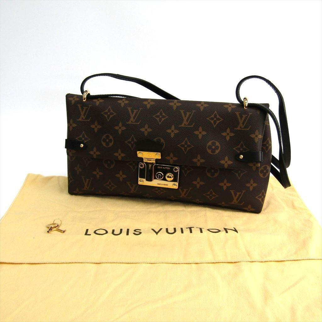 610fdff546a0 Lyst - Louis Vuitton Monogram Sac Triangle Pm in Brown