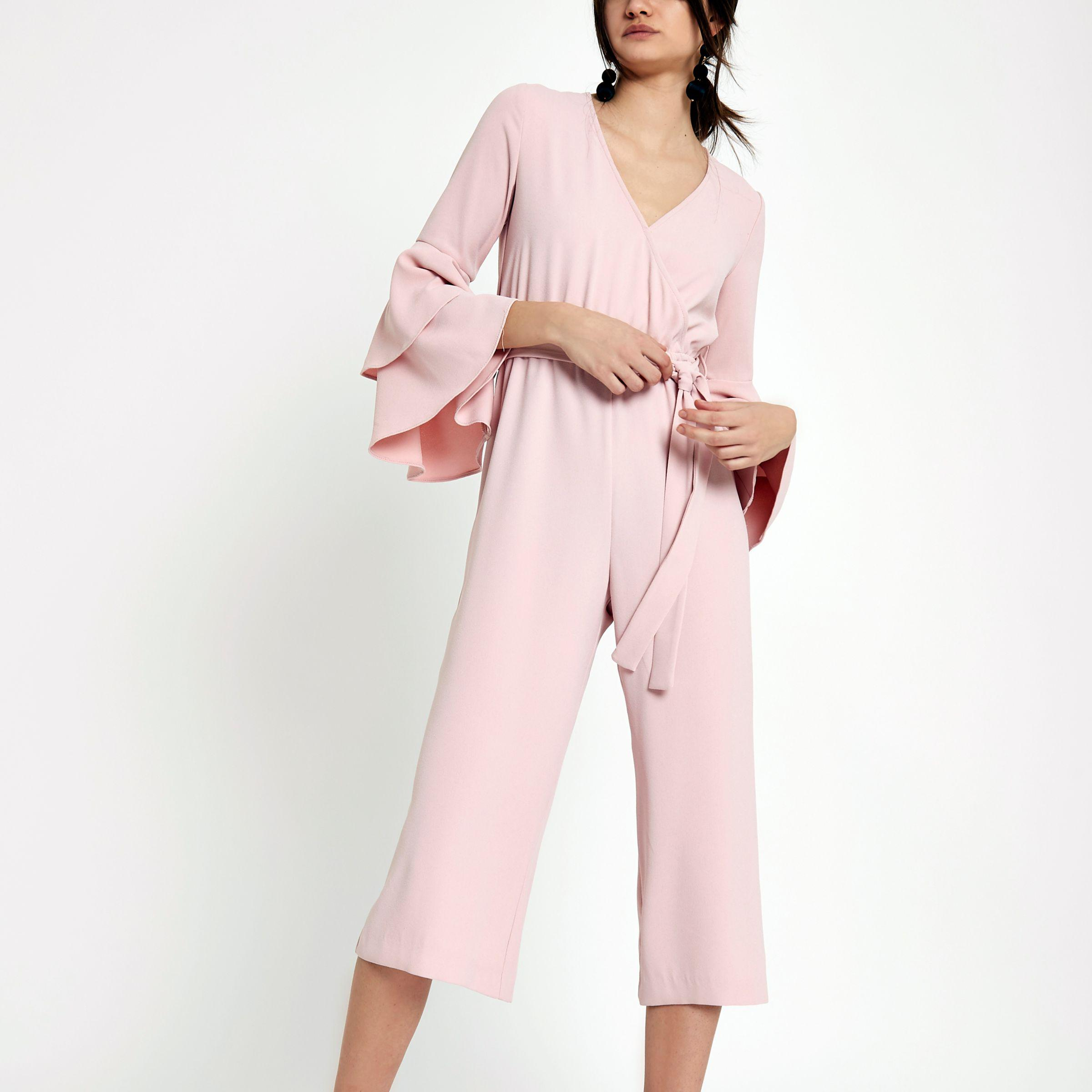 a7e790336cd Lyst - River Island Frill Sleeve Wrap Tie Waist Jumpsuit in Natural