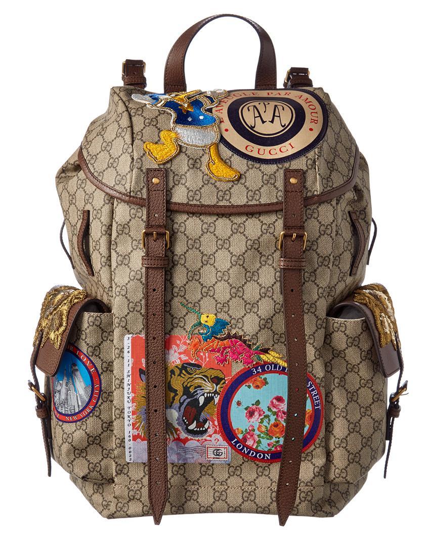 f77f2240ddc5d Gucci Gg Supreme Canvas Donald Duck Appliqué Backpack - Lyst