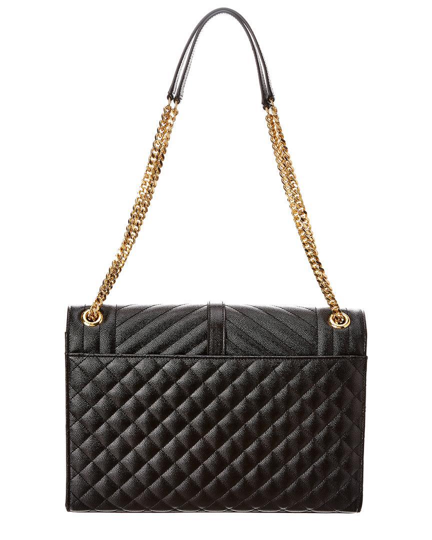 aad006a49e8d Saint Laurent. Women s Black Monogram Large Quilted Leather Envelope  Shoulder Bag