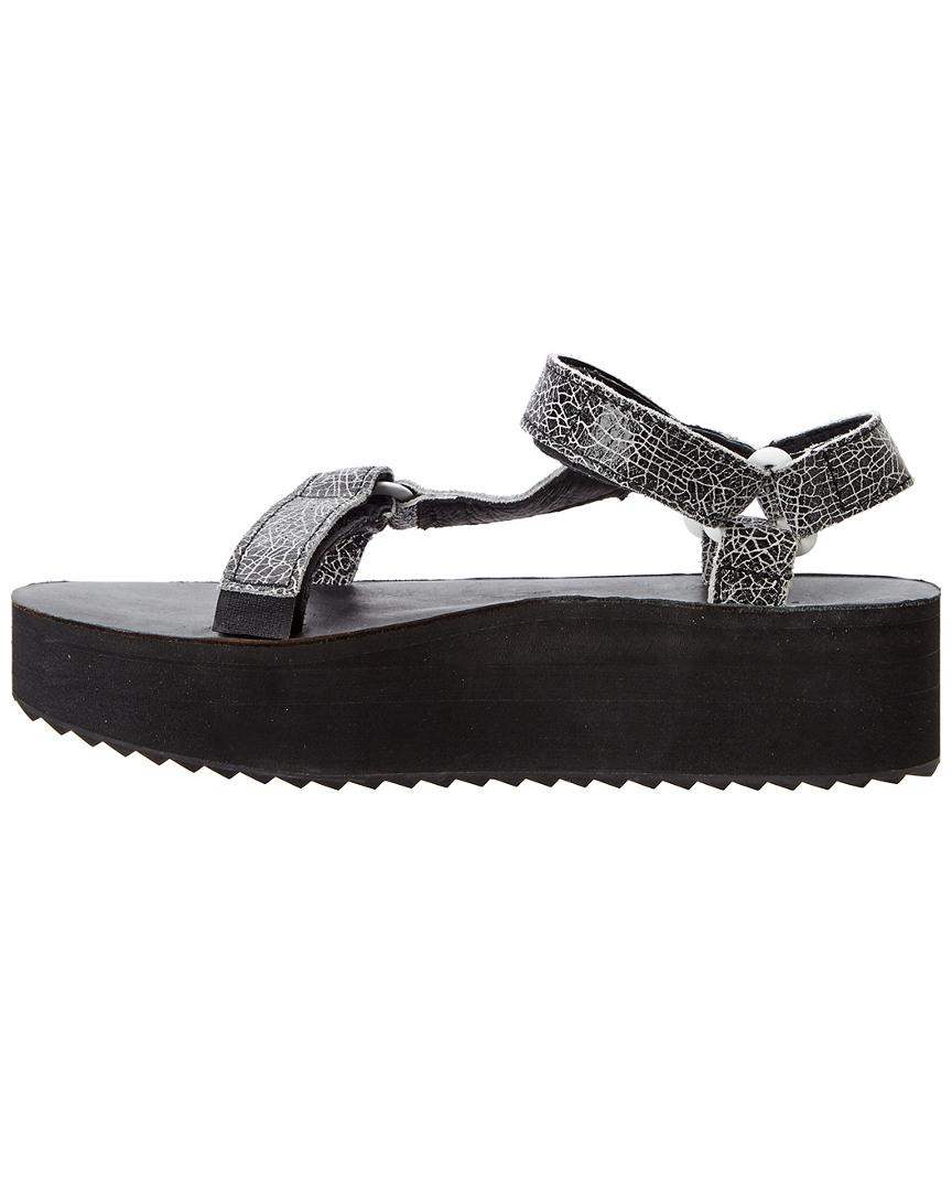 115af6147bc1 Lyst - Teva Women s Flatform Universal Crackle Leather Sandal in Black