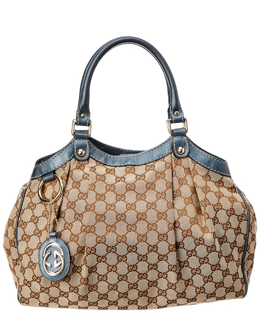 5f1799ba2e0 Lyst - Gucci Brown GG Canvas   Blue Leather Sukey in Blue