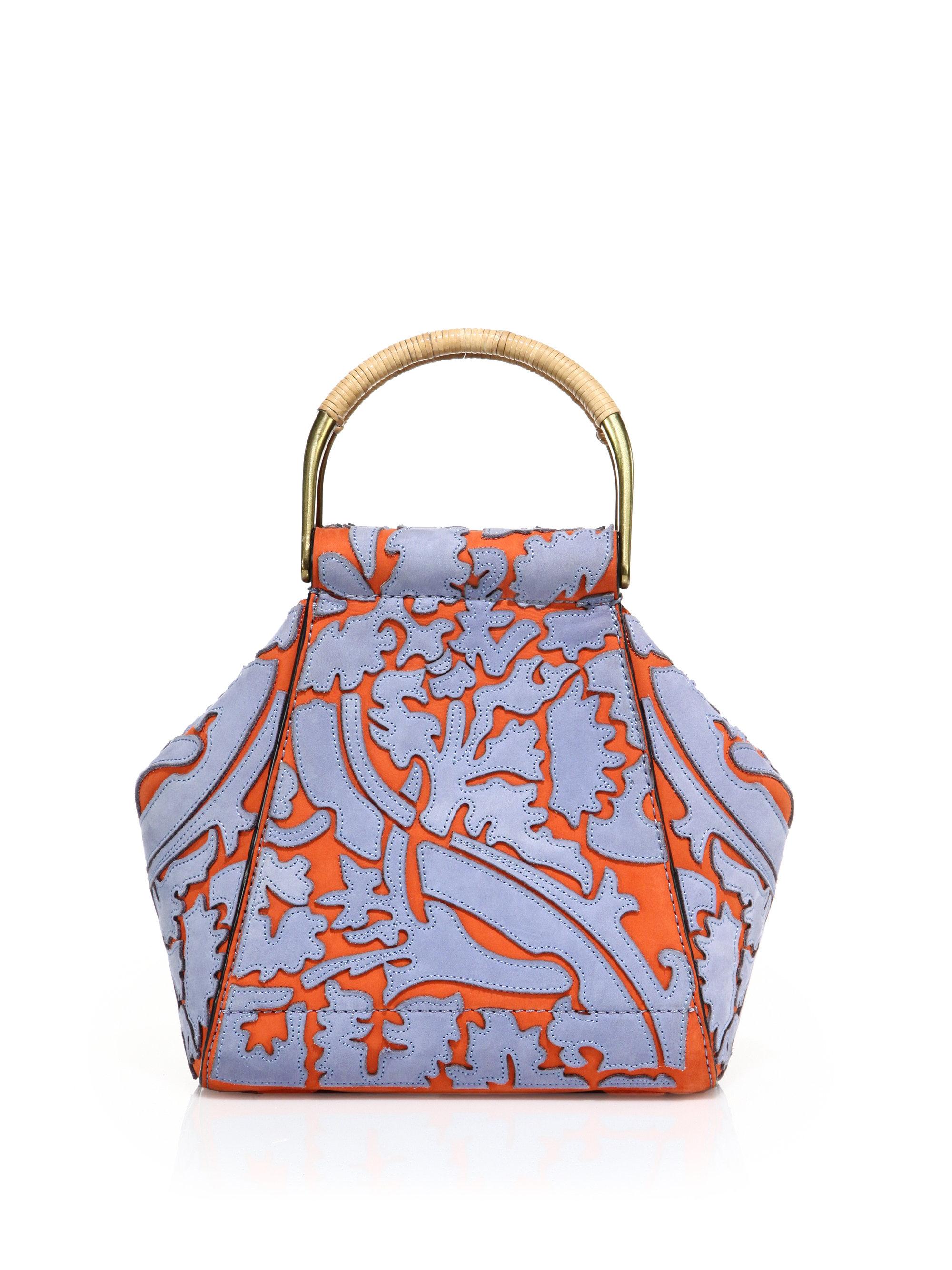 f2a81ff08767 Lyst - Tory Burch Vine Half Moon Leather Bag in Orange