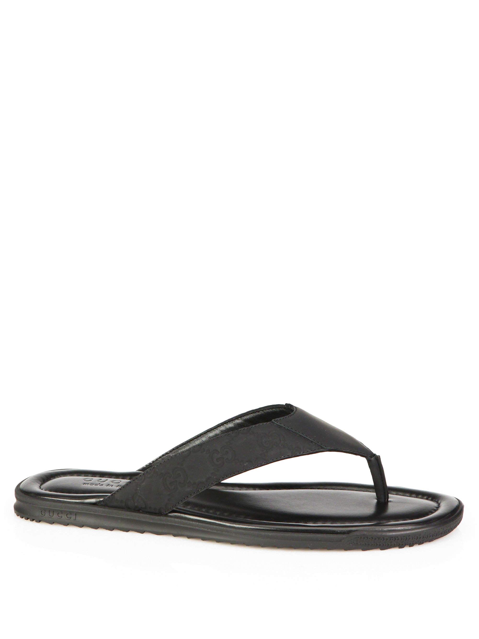 e930f965c818 Lyst - Gucci Rubberized Leather Gg Thong Flip Flops in Black for Men