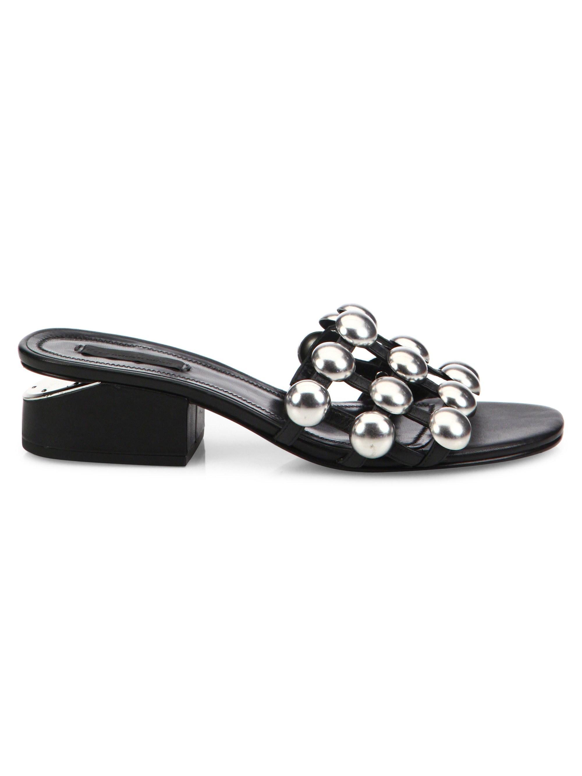 c5af0ad6073 Lyst - Alexander Wang Lou Tilt-heel Studded Leather Slides in Black
