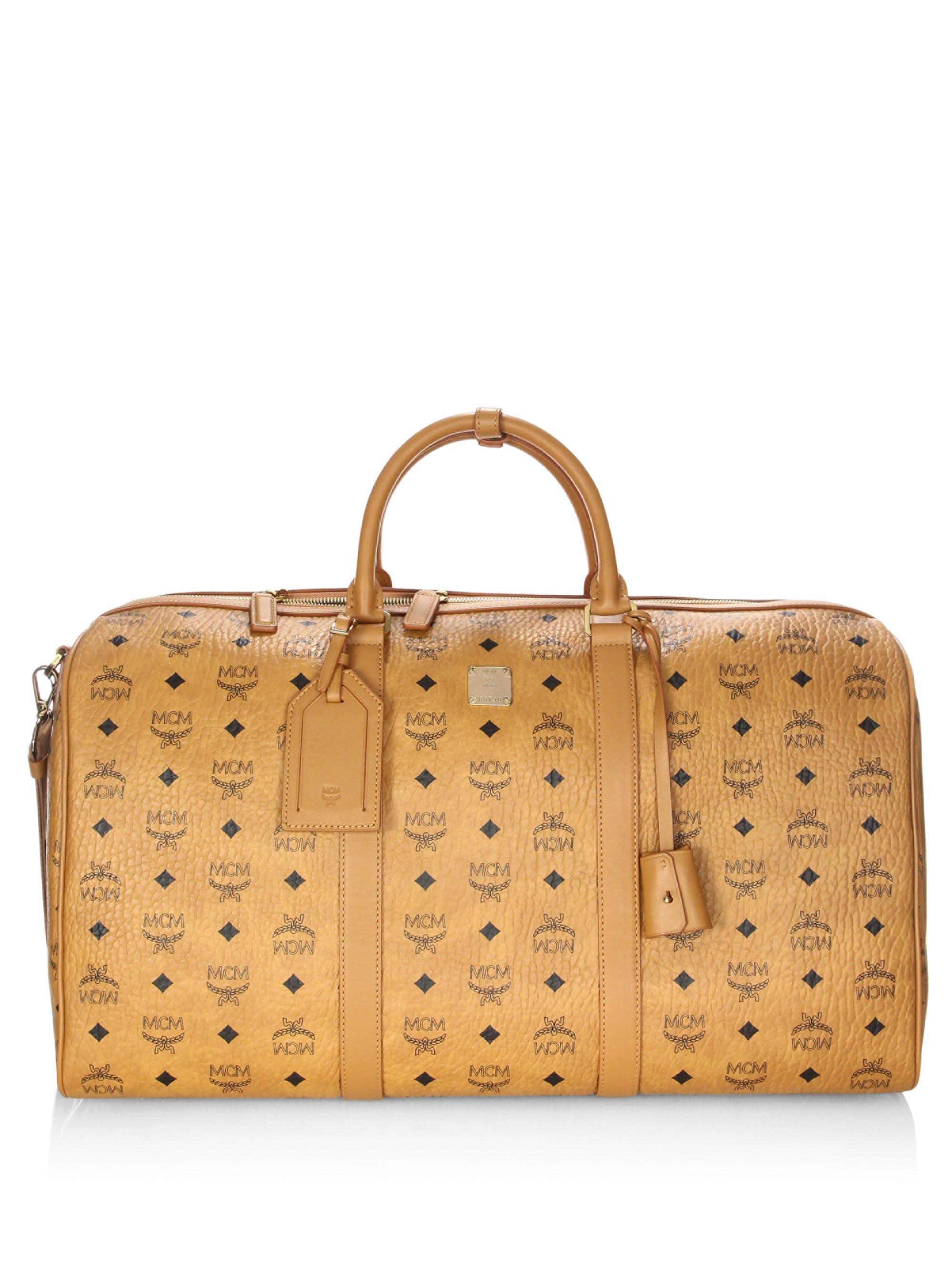 08b93e2ecf Lyst - MCM Women s Large Voyager Visetos Traveler Weekender - Cognac ...