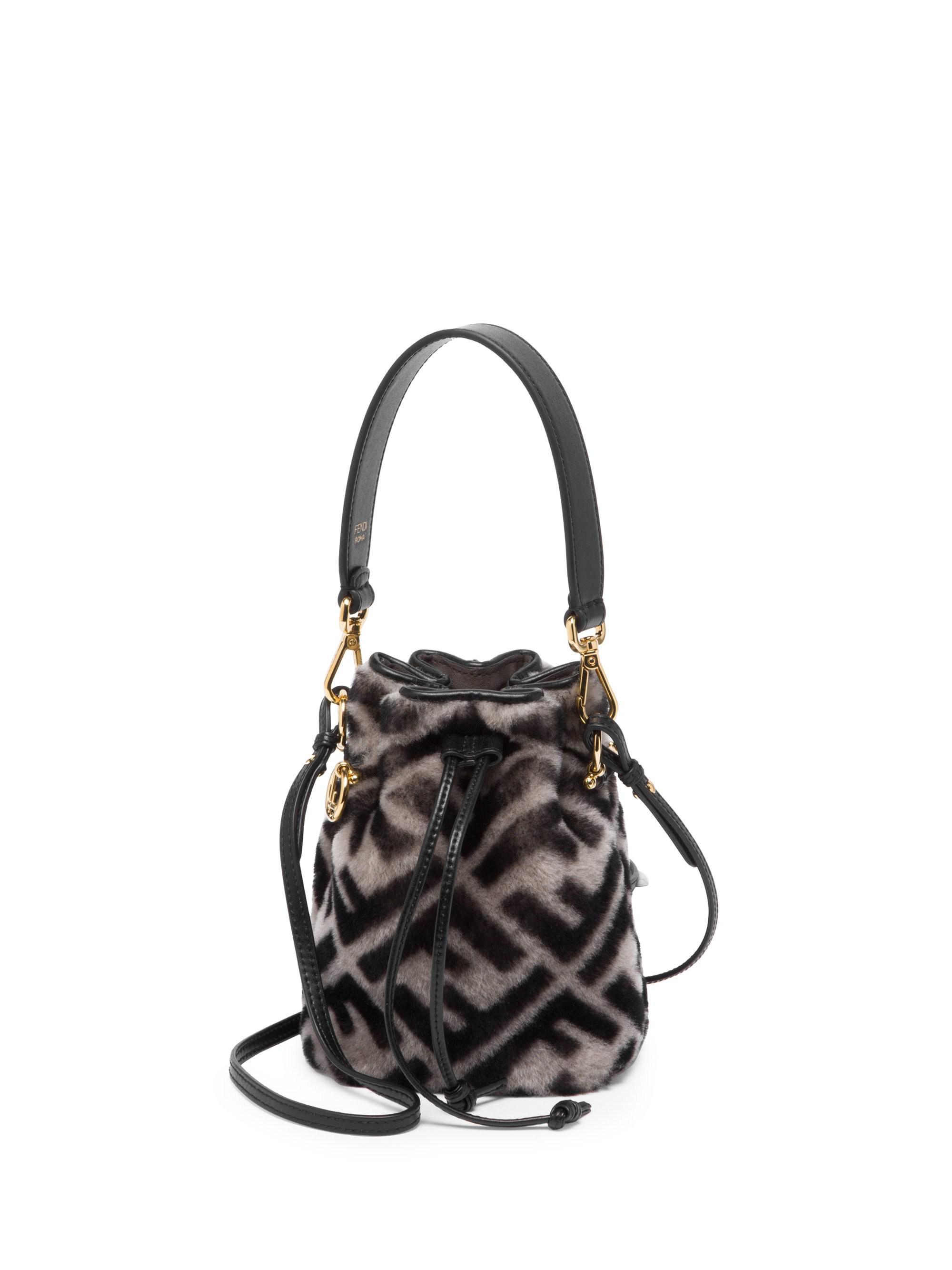 0887e35daba3 Fendi Mini Mon Tresor Shearling Bucket Bag in Black - Lyst