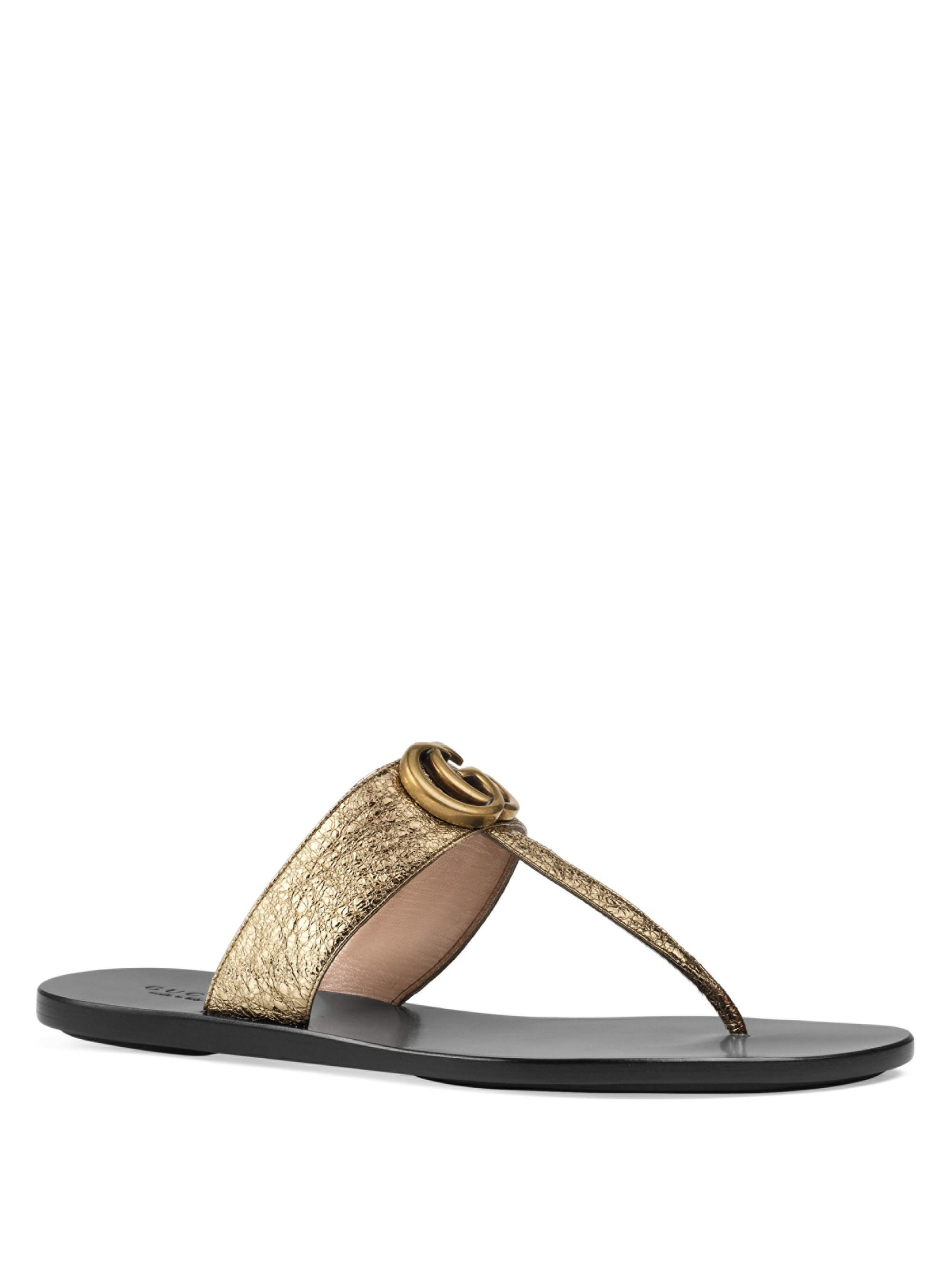 e3f88ccced42 Gucci. Women s Marmont Leather Thong Sandals With Double G
