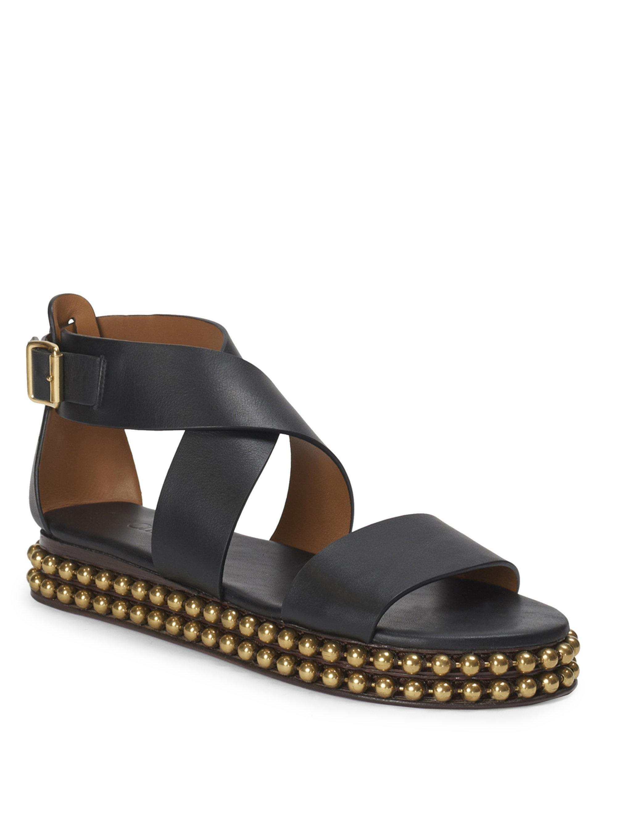 6a7ebd110a3364 Chloé Sawyer Studded Leather Wrap Gladiator Sandals in Black - Lyst