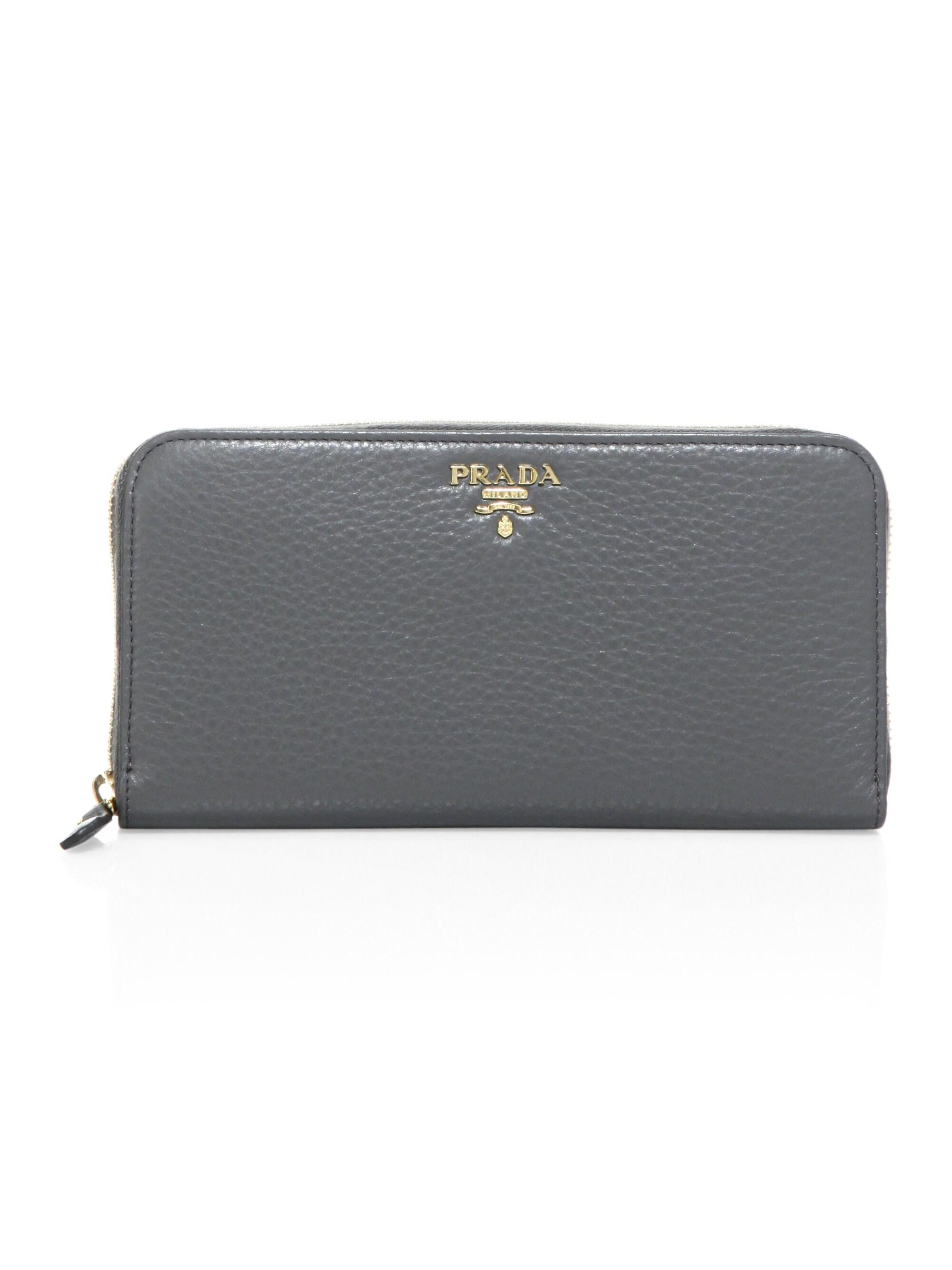 53b8d0a4d7f0f4 Prada Women's Leather Zip-around Wallet - Caramel Papaya in Gray - Lyst