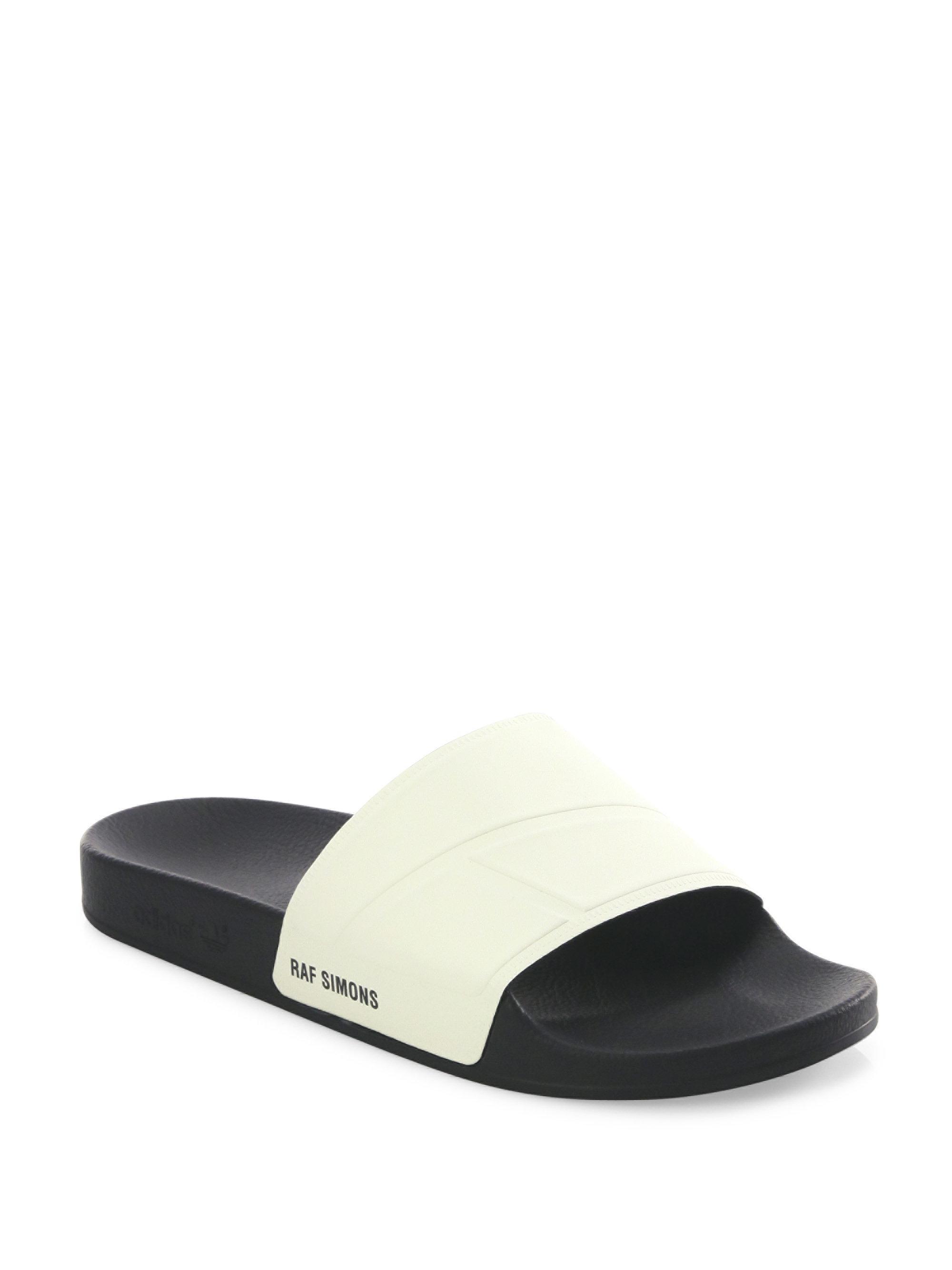 b5075fb6fdfba adidas By Raf Simons. Men s Bunny Adilette Rubber Slides - White Black ...