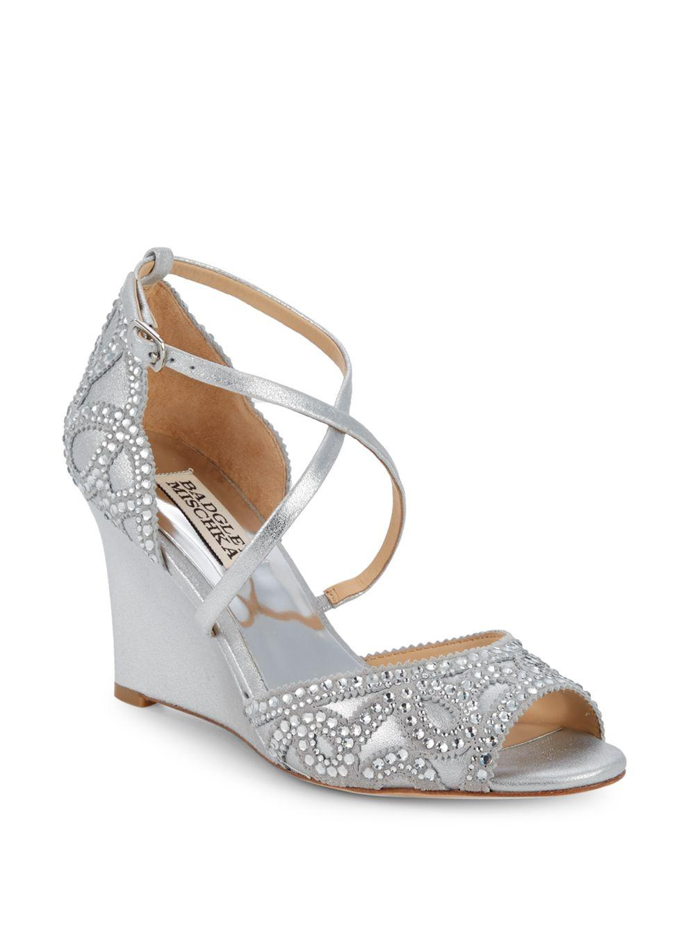 6e59aebe4de Badgley Mischka. Women s Metallic Embellished Leather Wedge Dress Sandals