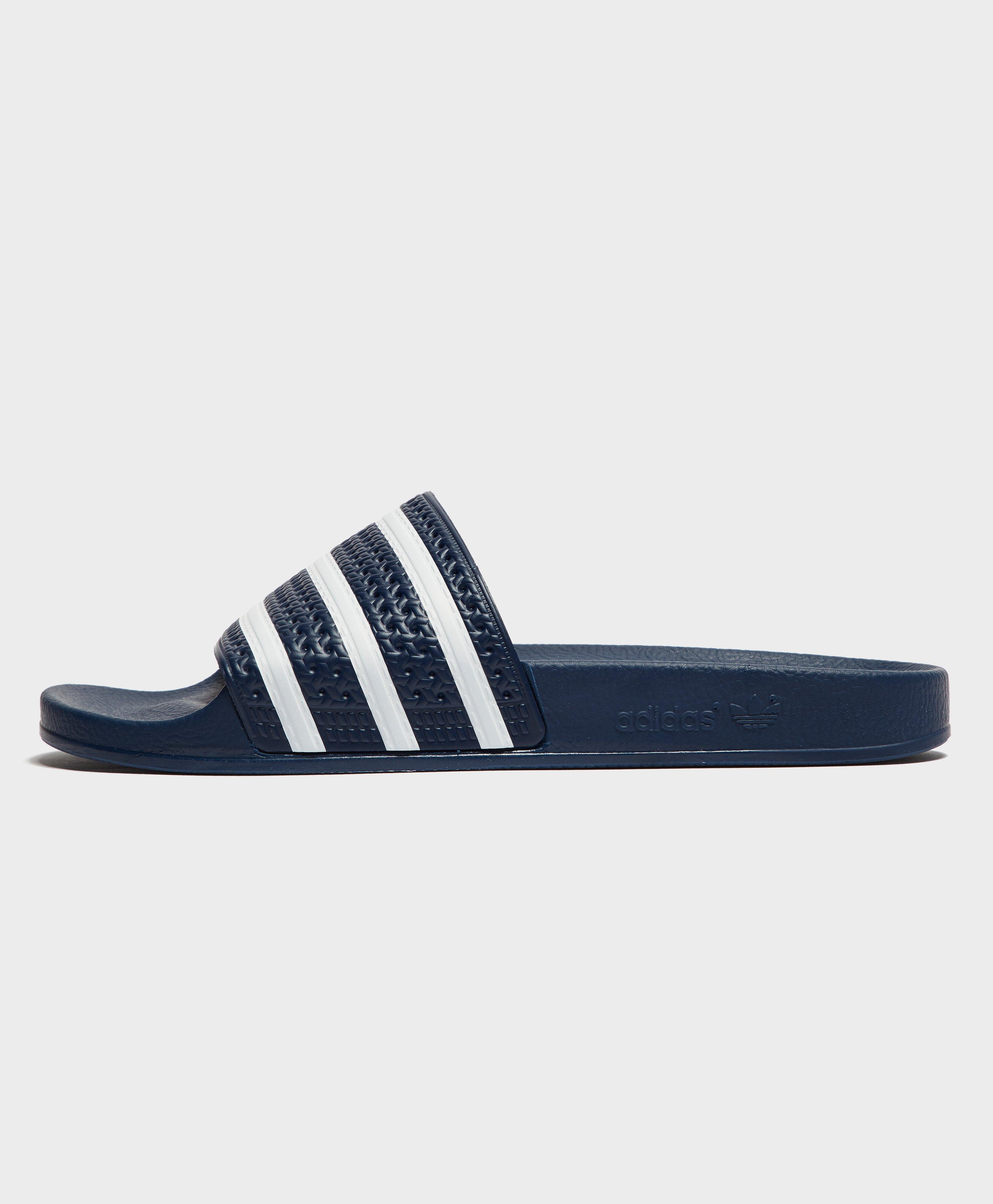 huge selection of 36b64 0d5d1 Adidas Originals - Blue Adilette Slides for Men - Lyst. View fullscreen